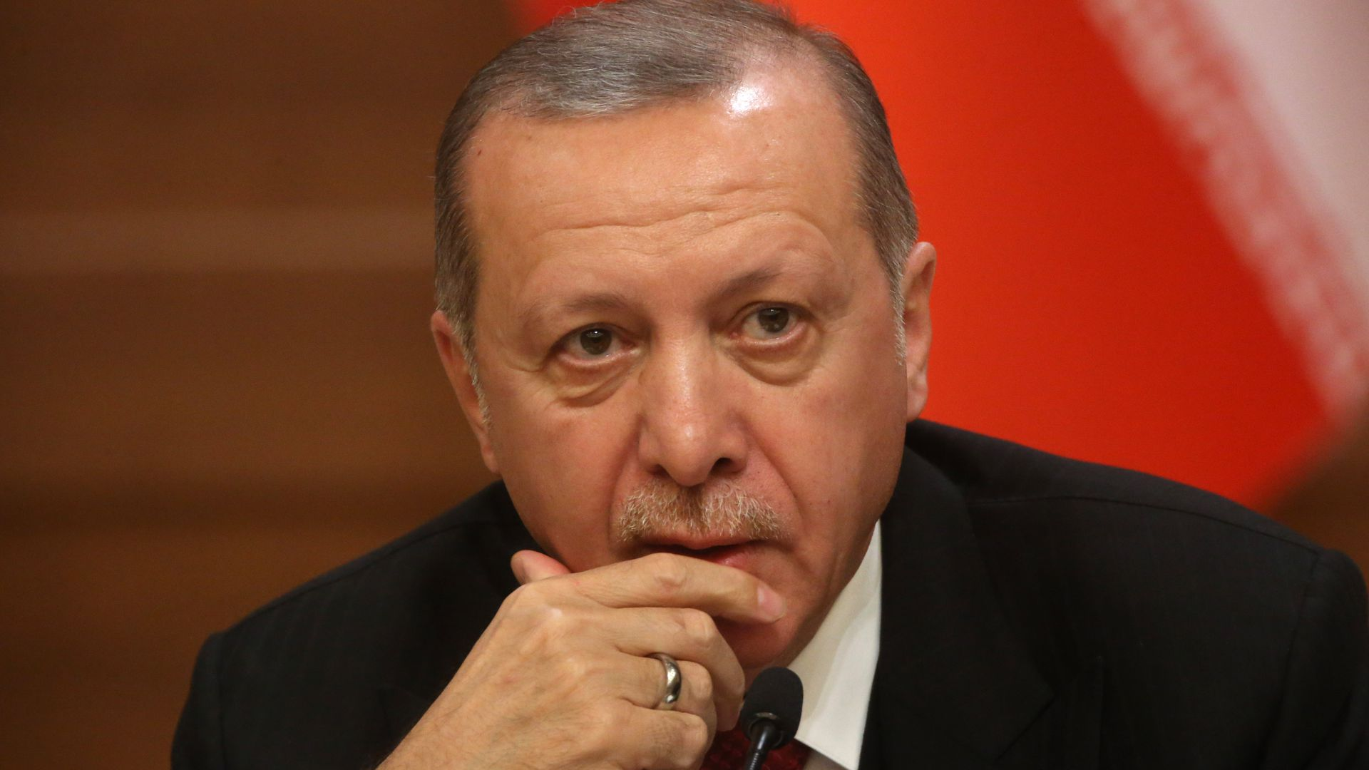 Turkish President Recep Tayyip Erdogan listens during a press conference.