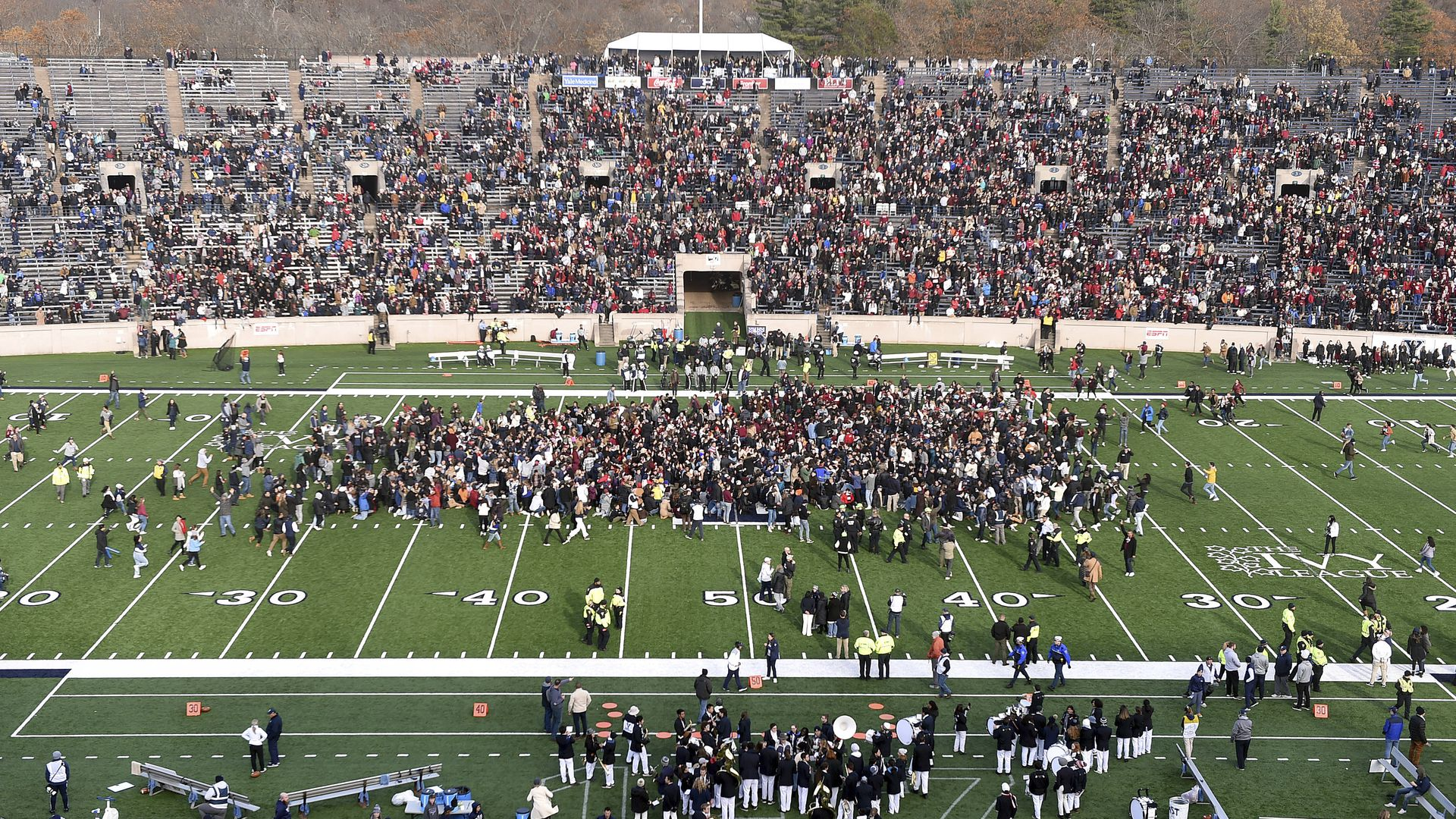 Protesters swarm the field at a Harvard-Yale football game.