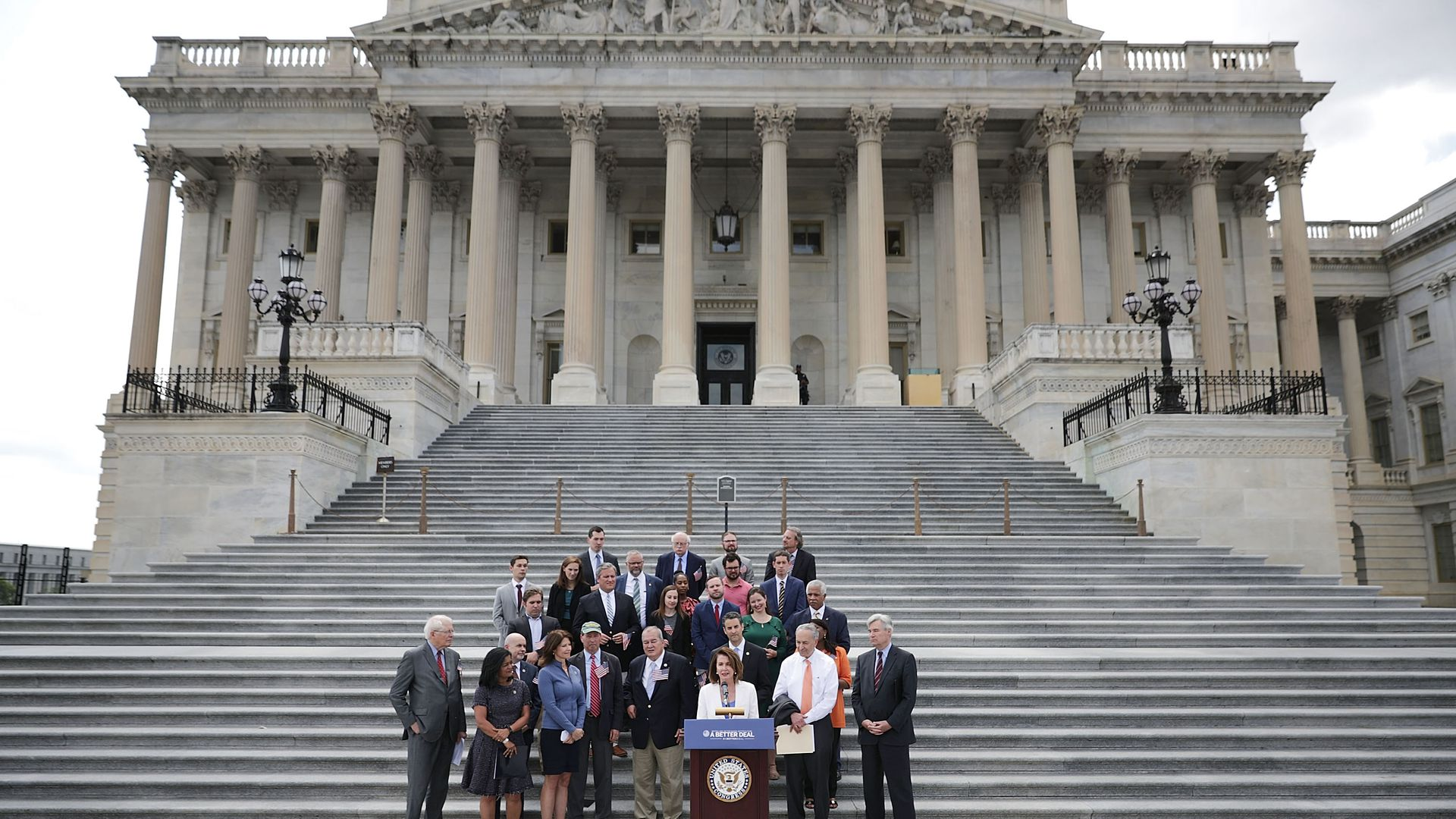 House and Senate Democratic leadership in front of the Capitol.
