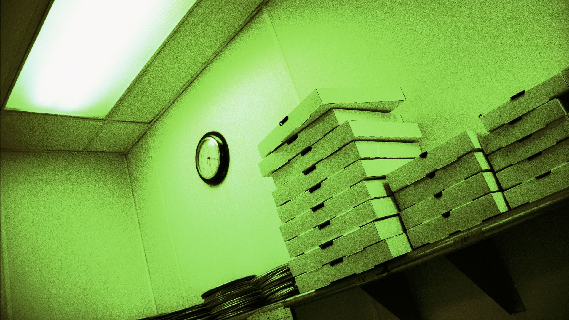 Stacked empty pizza boxes