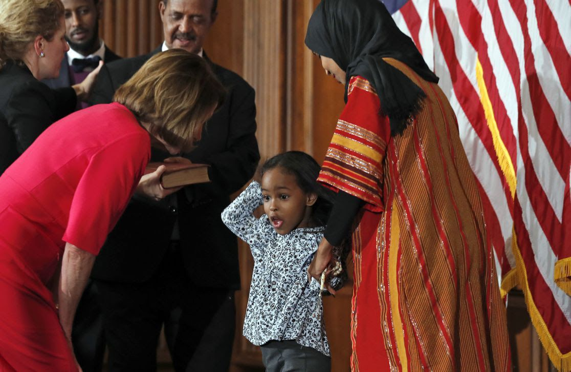 Nancy Pelosi greets child with Ilhan Omar.