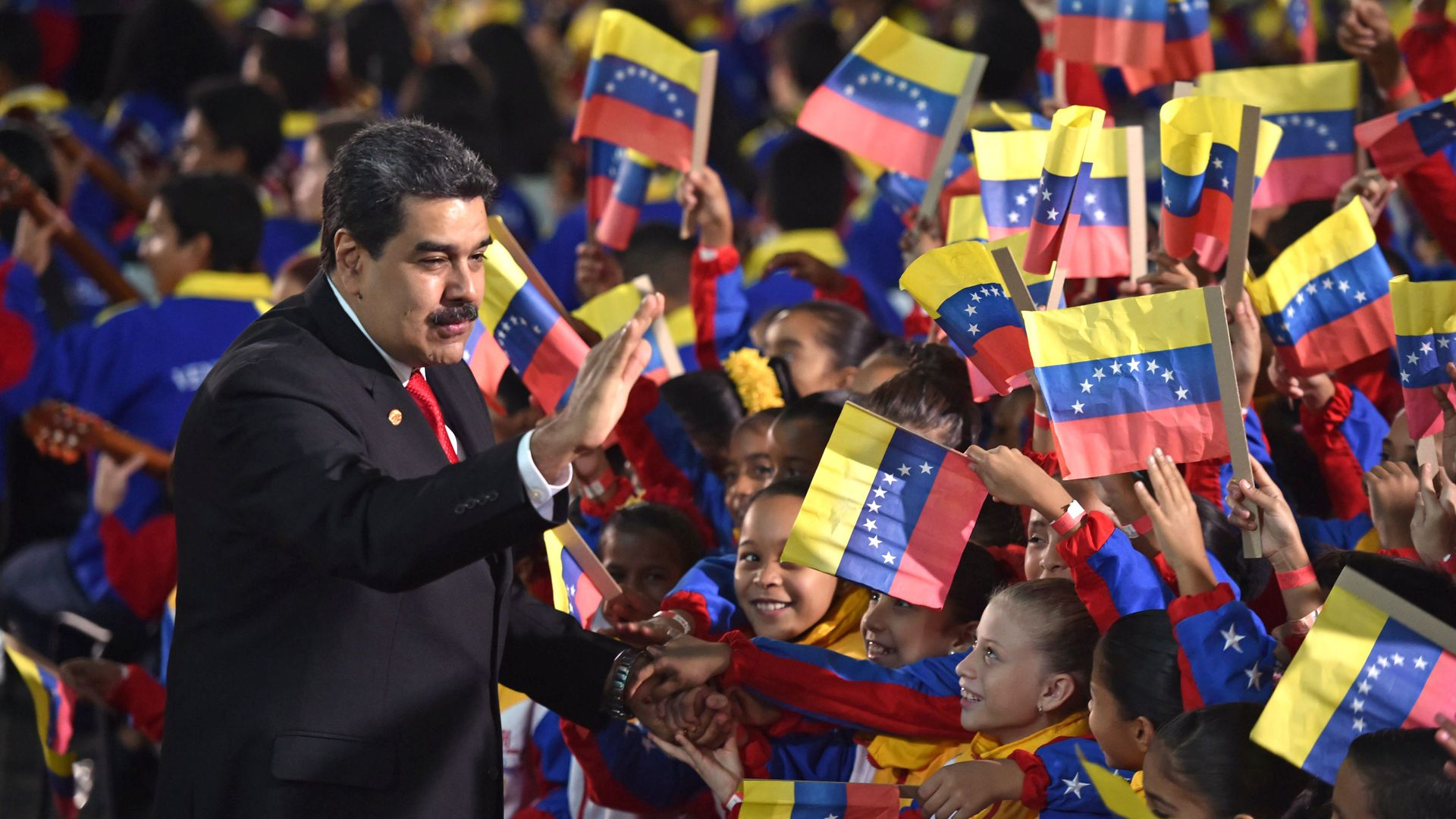 Venezuela's President Nicolas Maduro greets children upon arrival for the inauguration ceremony of his second mandate