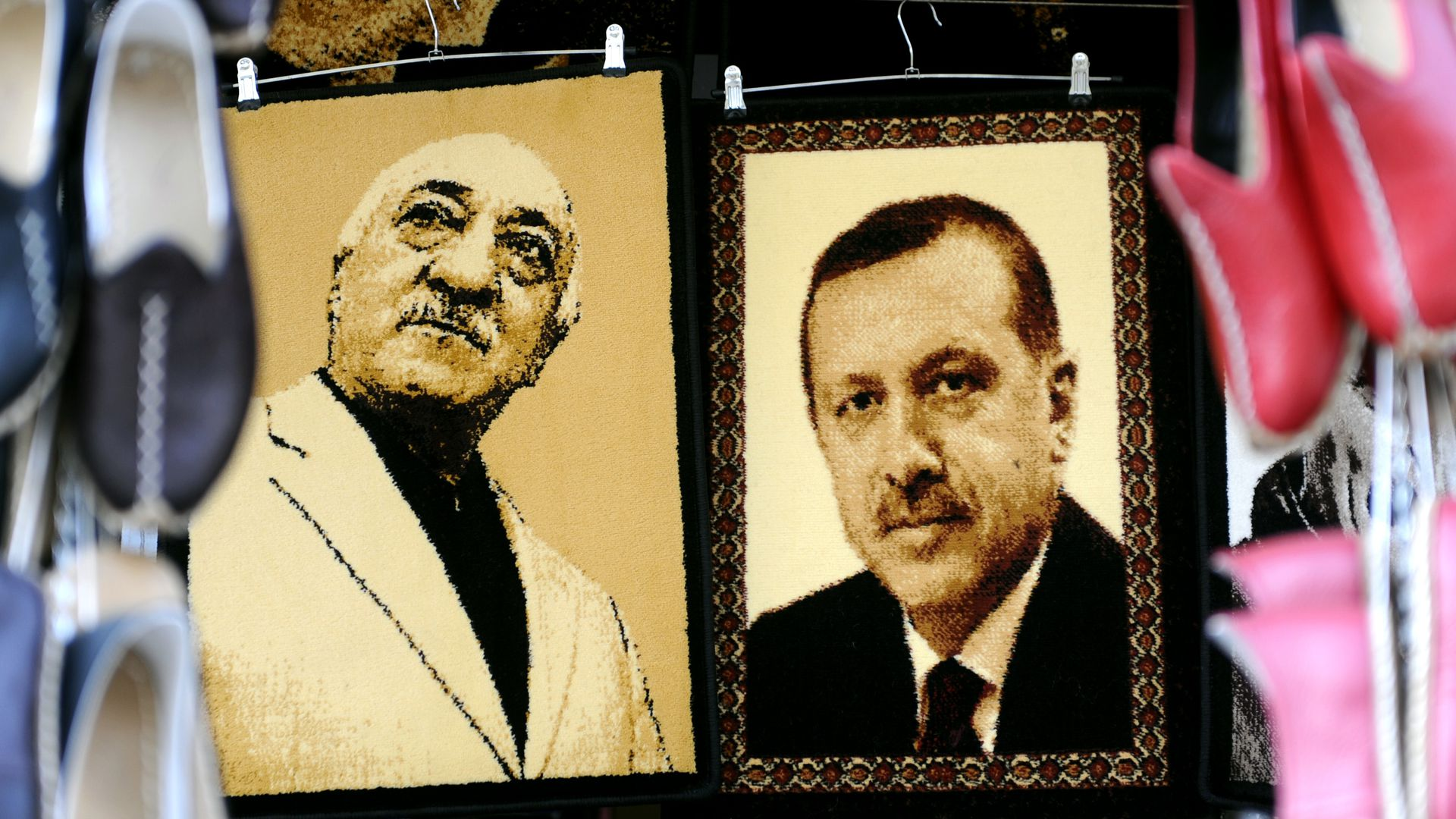 Embroidered images of Turkish cleric Fetullah Gulen (L) and President Recep Tayyip Erdogan (R)