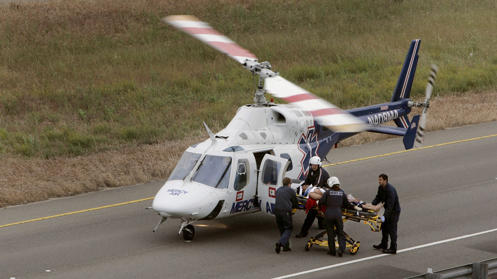 Crash victim being loaded into an air ambulance