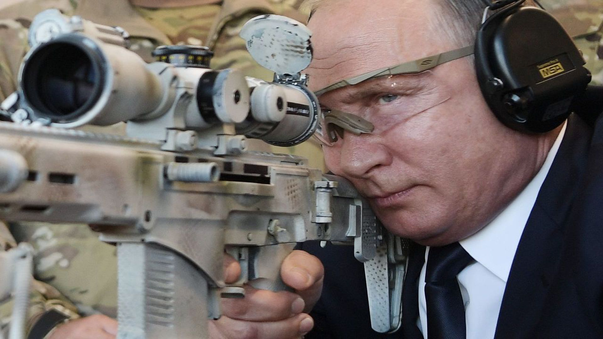 Vladimir Putin shoots an advanced Kalashnikov sniper rifle during a visit to the military-themed Patriot Park outside Moscow, in September. Photo: Alexey Nikolsky/AFP/Getty Images