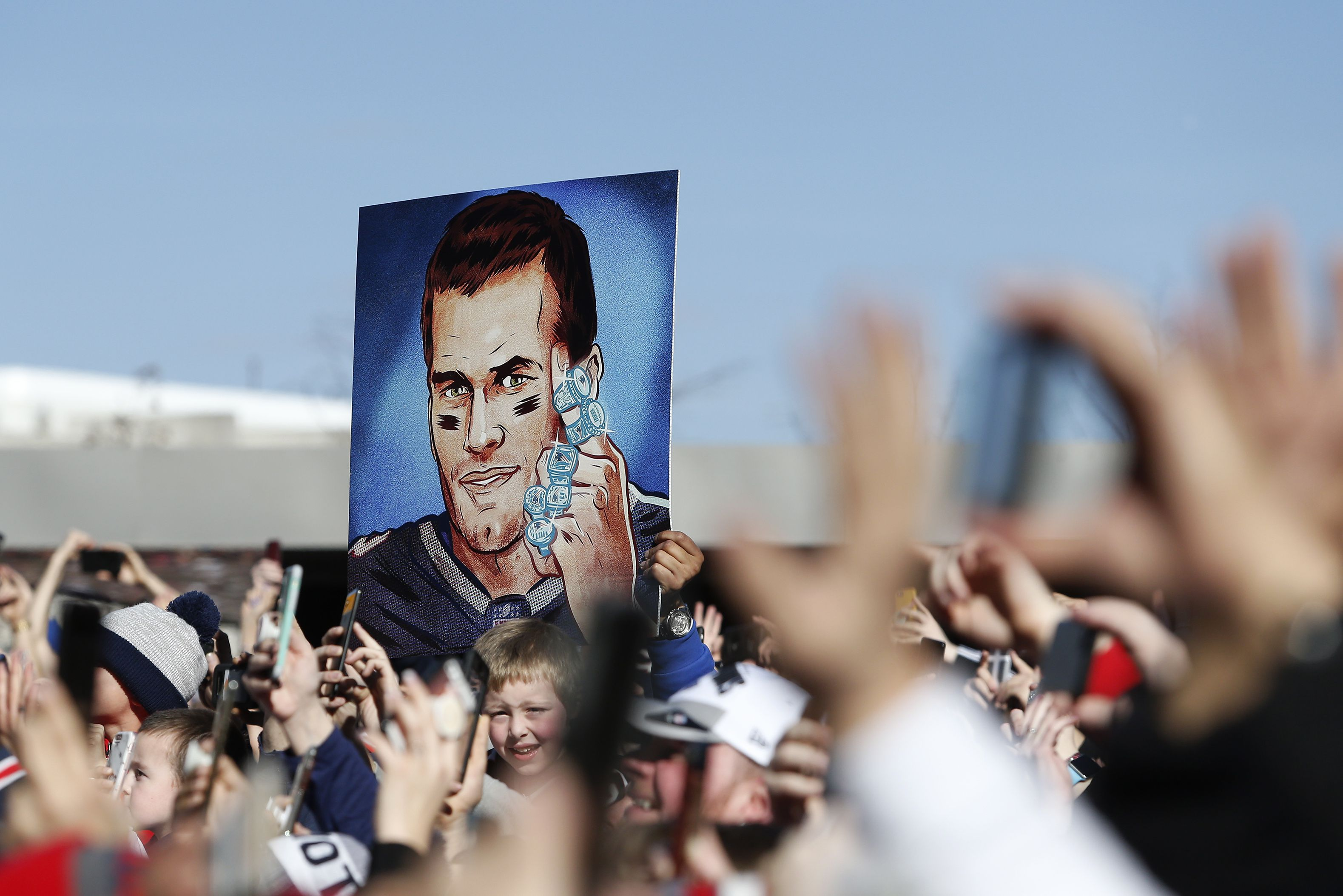 A Tom Brady sign in the middle of the crowd