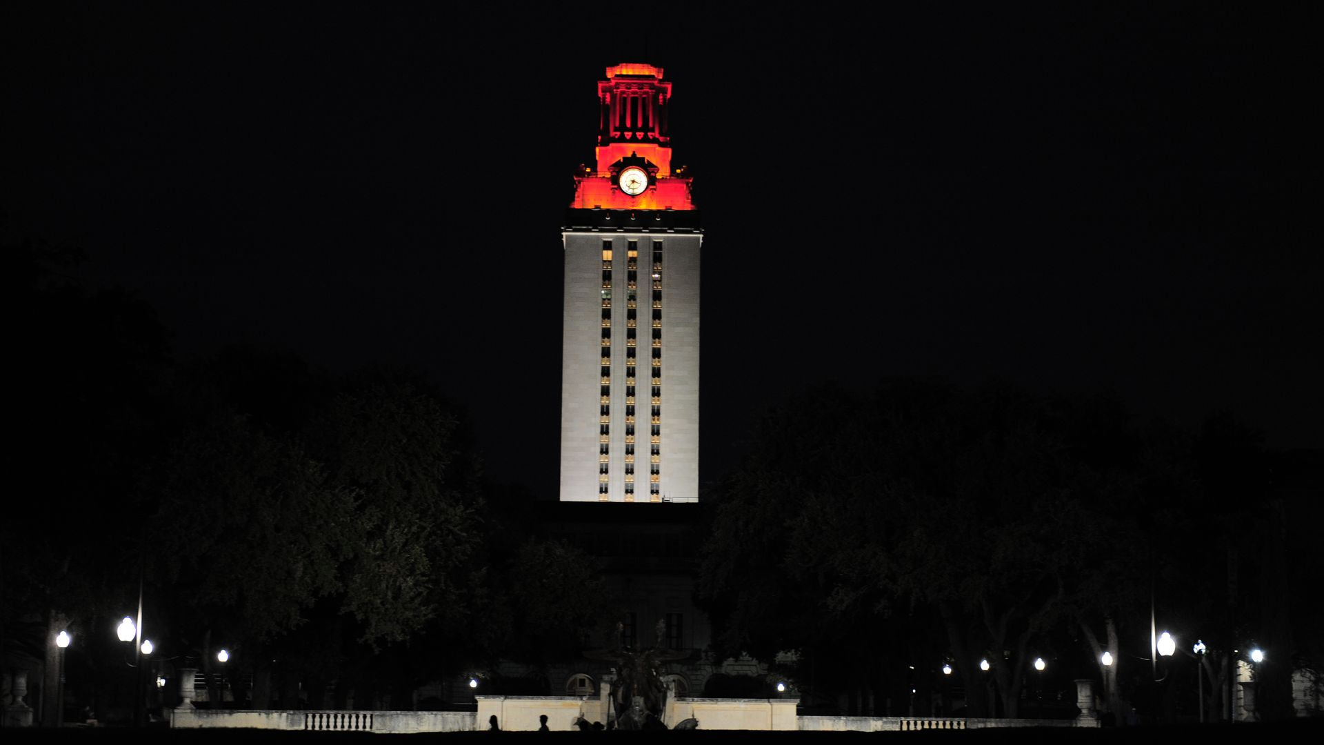 The University of Texas tower shines burnt orange at night.