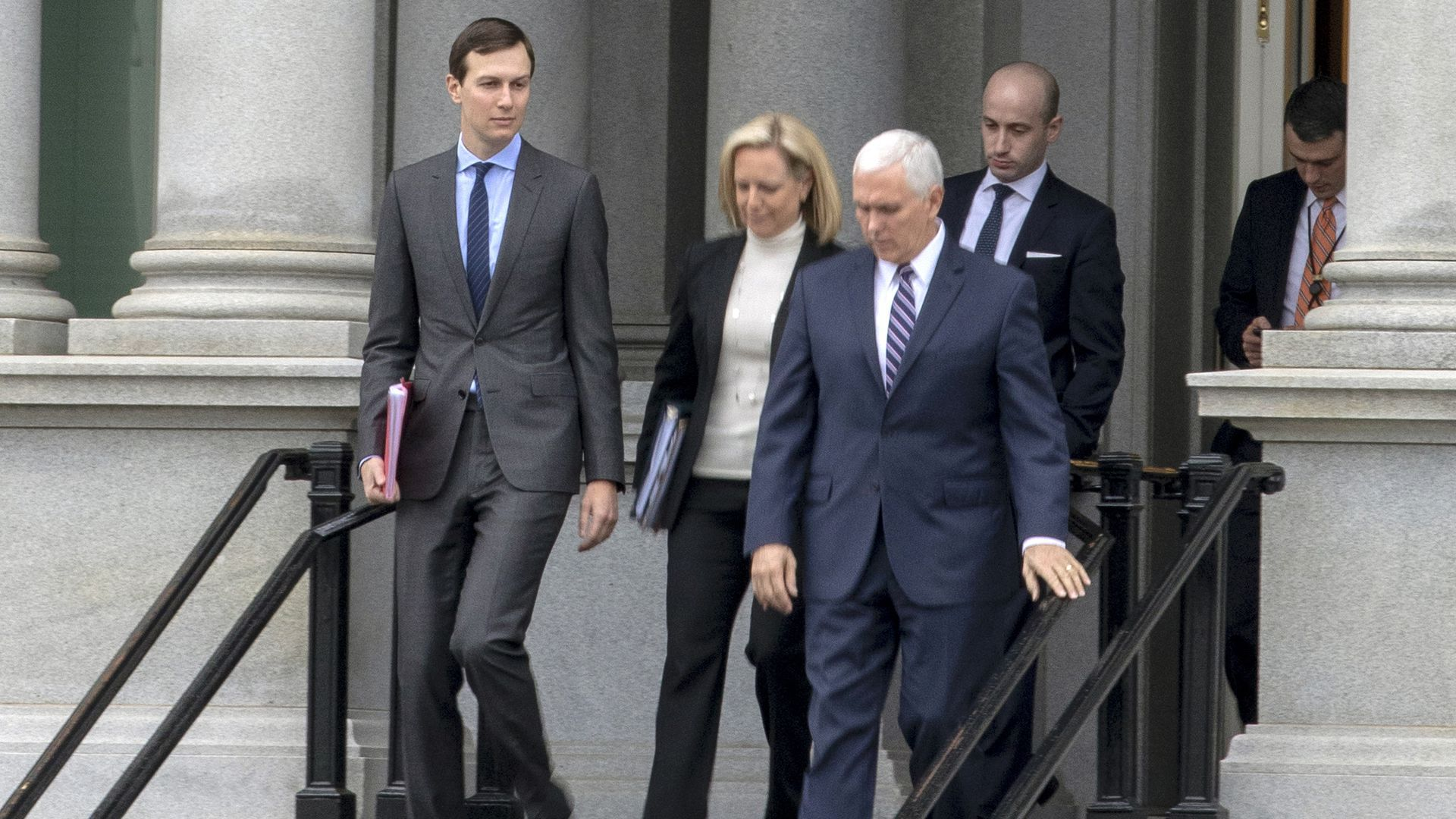 Jared Kushner walks down stairs followed by Mike Pence, Kirstjen Nielsen and Stephen Miller