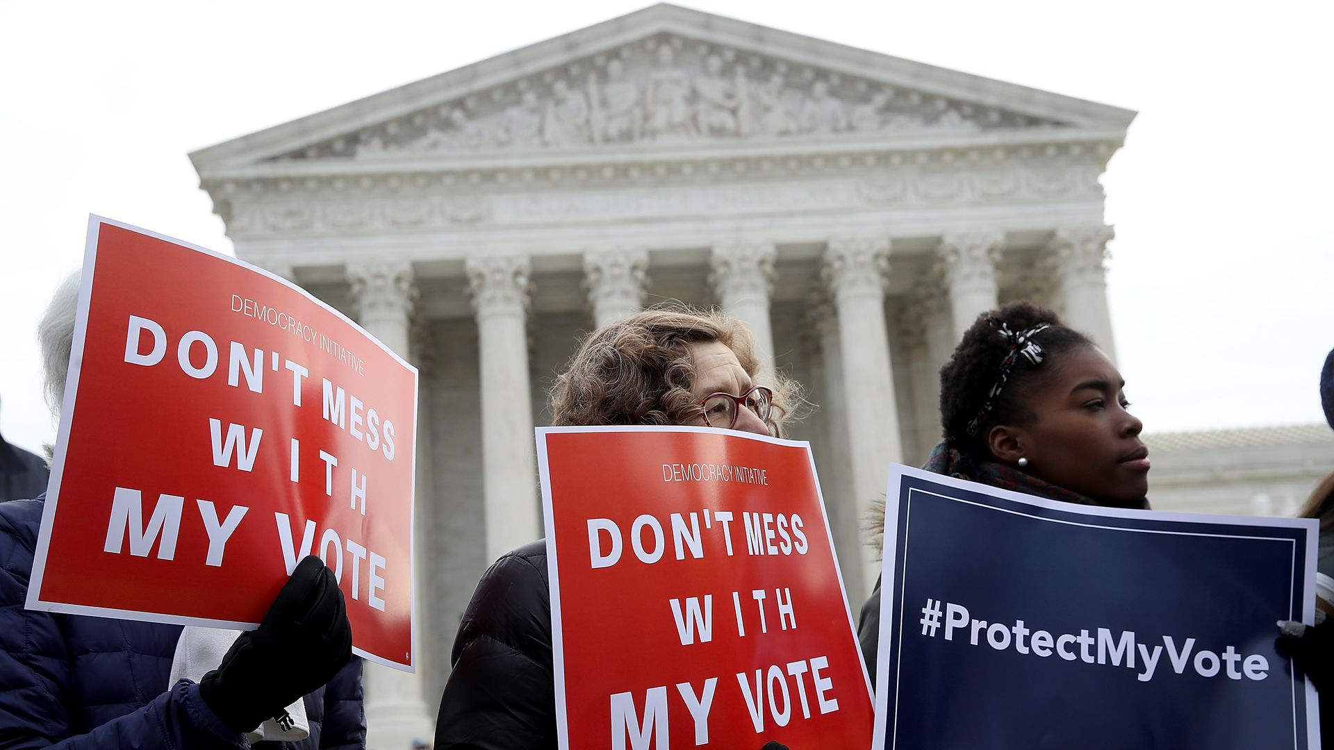 Protesters outside the U.S. Supreme Court Cause in January it is hears arguments in a challenge to Ohio's voter roll purges.