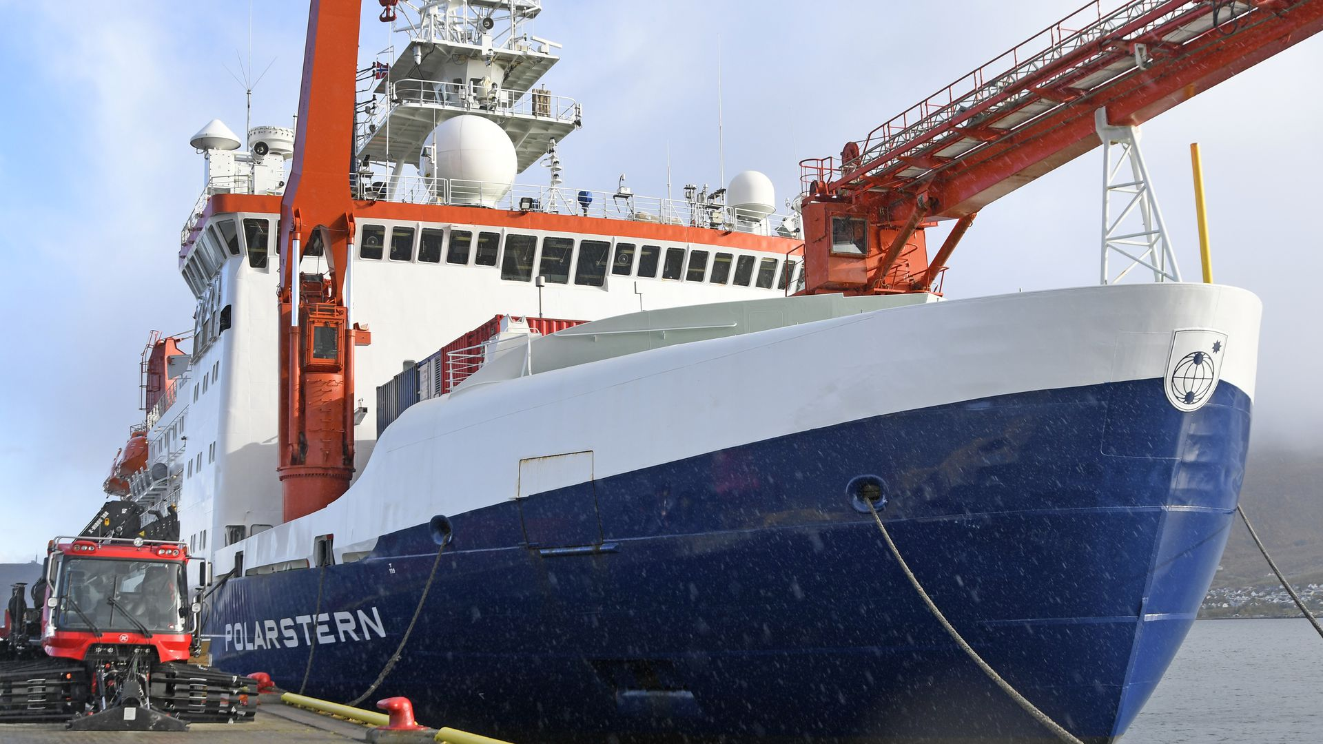 In this image, the research vessel Polarstern is docked and faces the camera nearly head on