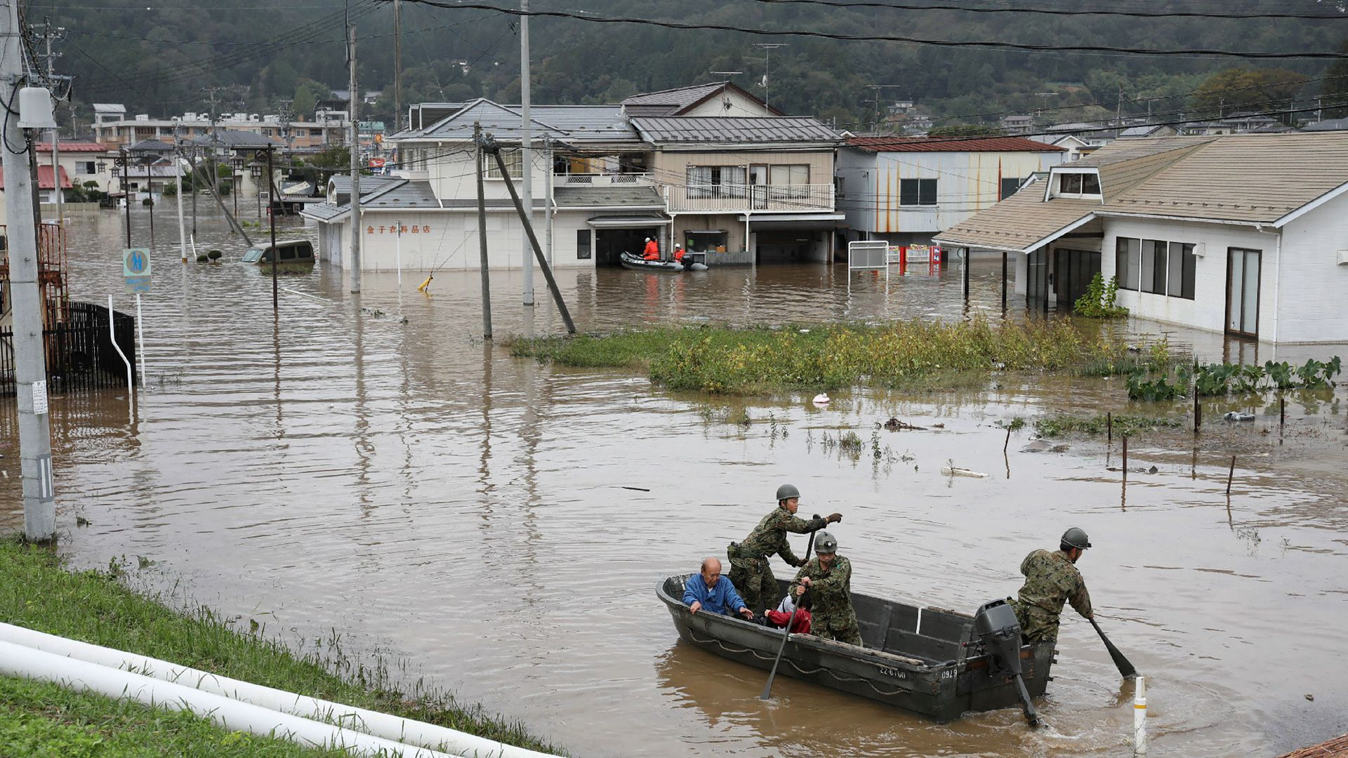 Japan Self-Defense Forces evacuate residents from a flooded area during search and rescue operations in the aftermath of Typhoon Hagibis in Marumori, Miyagi prefecture on October 14, 2019