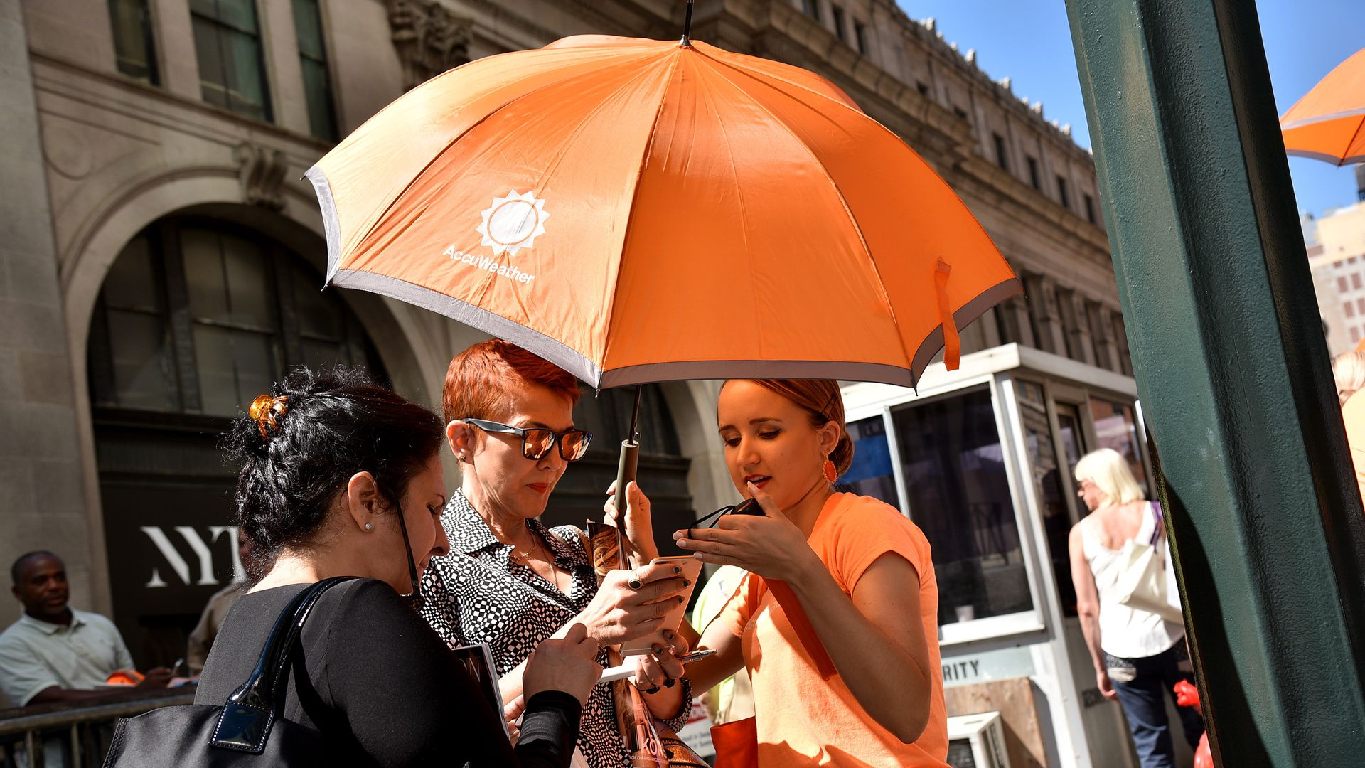 An Accuweather representative talks to two people