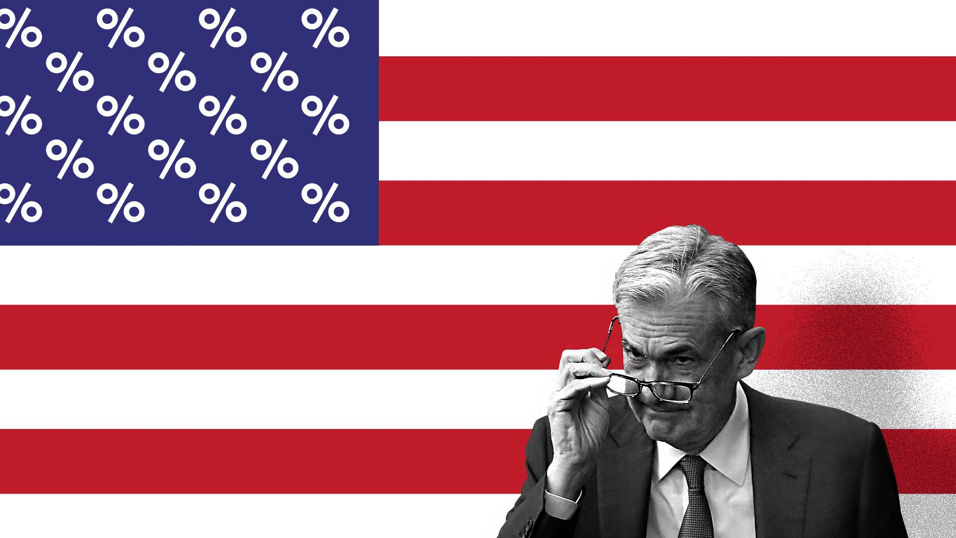 Jay Powell standing in front of a U.S. flag with the stars replaced by percent signs