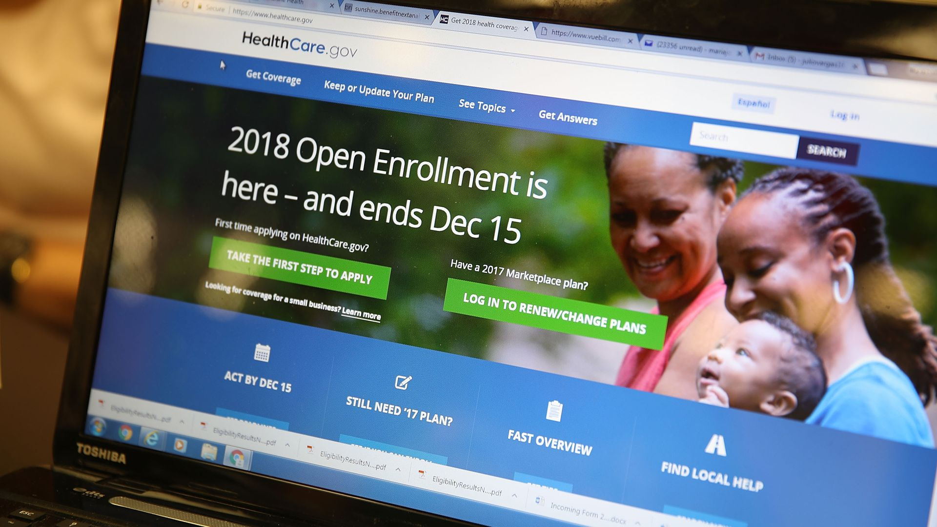 A laptop screen showing the 2018 enrollment page for ACA