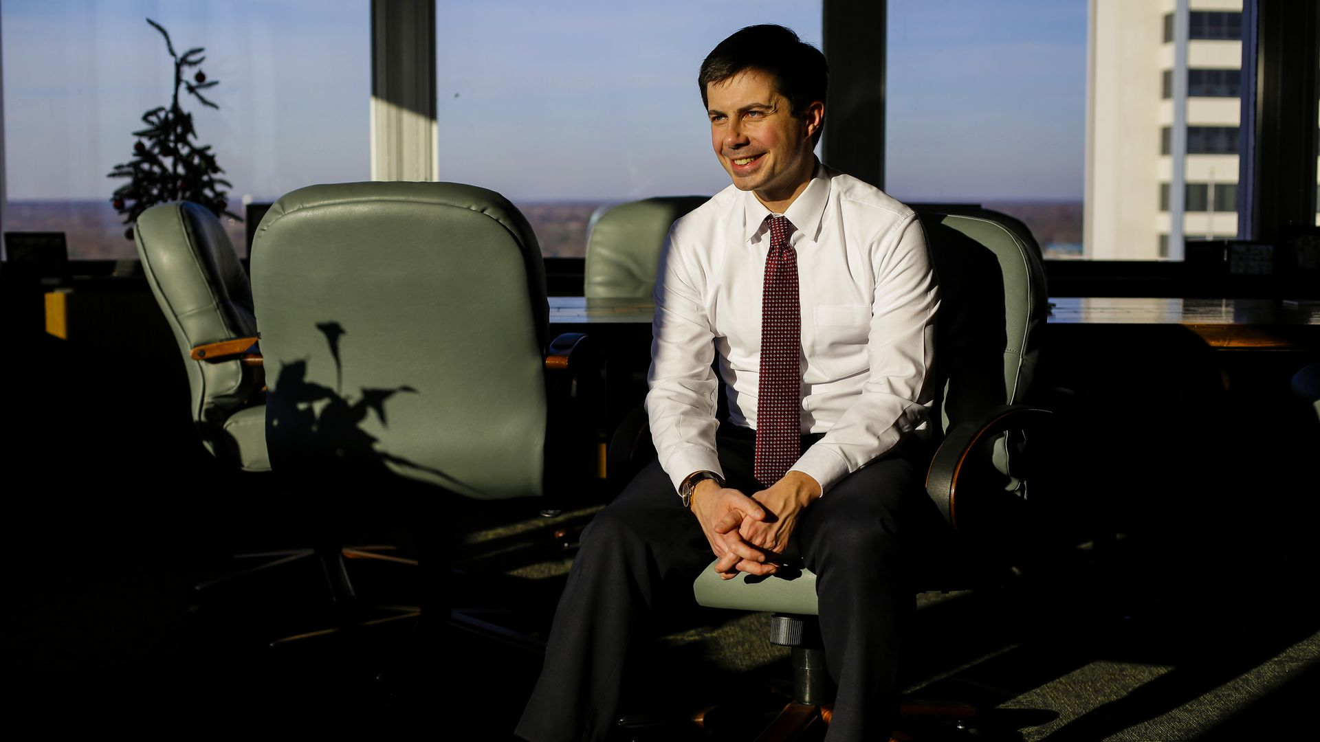 Peter Buttigieg sitting in an office chair