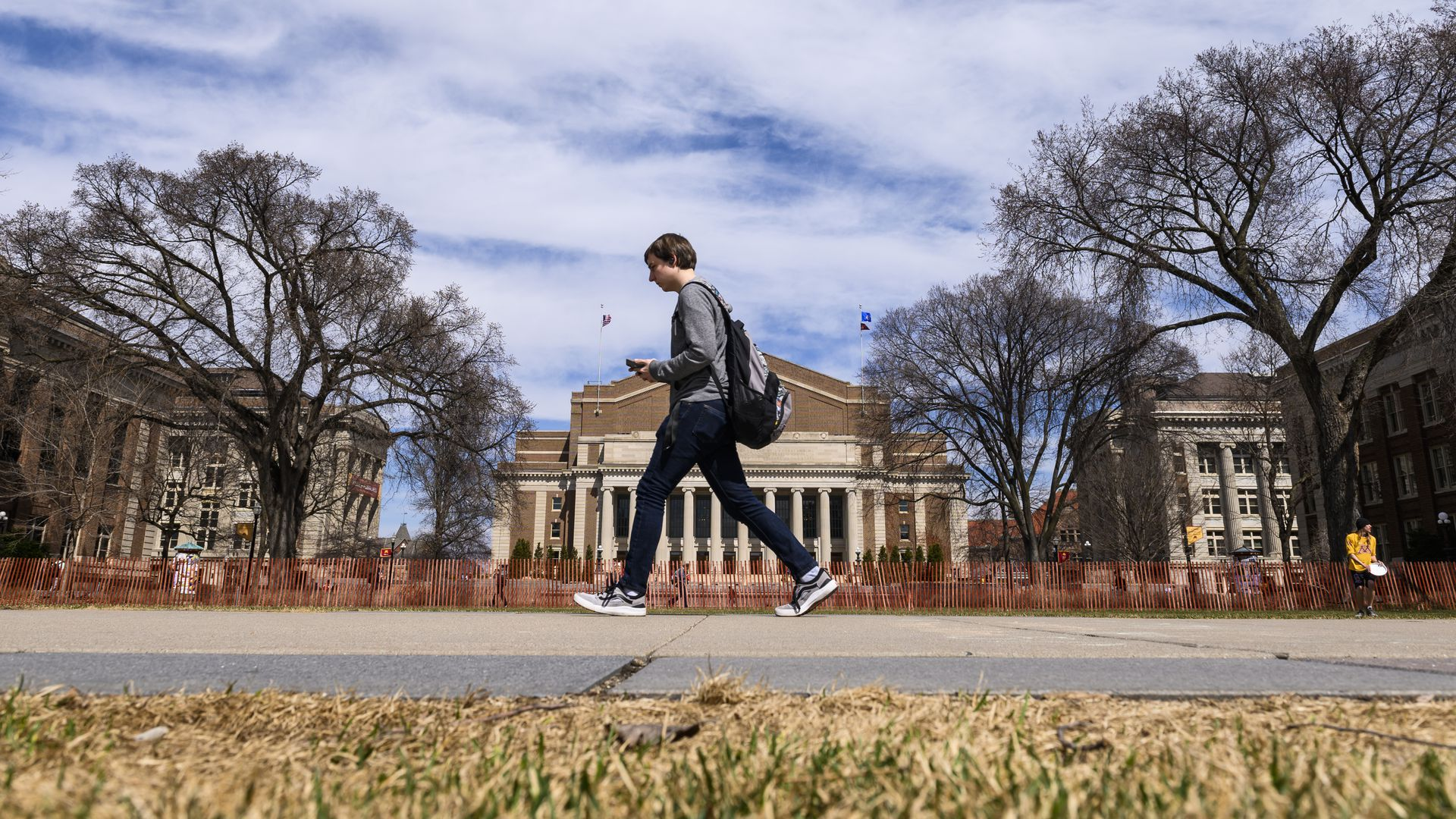 A student walks across campus