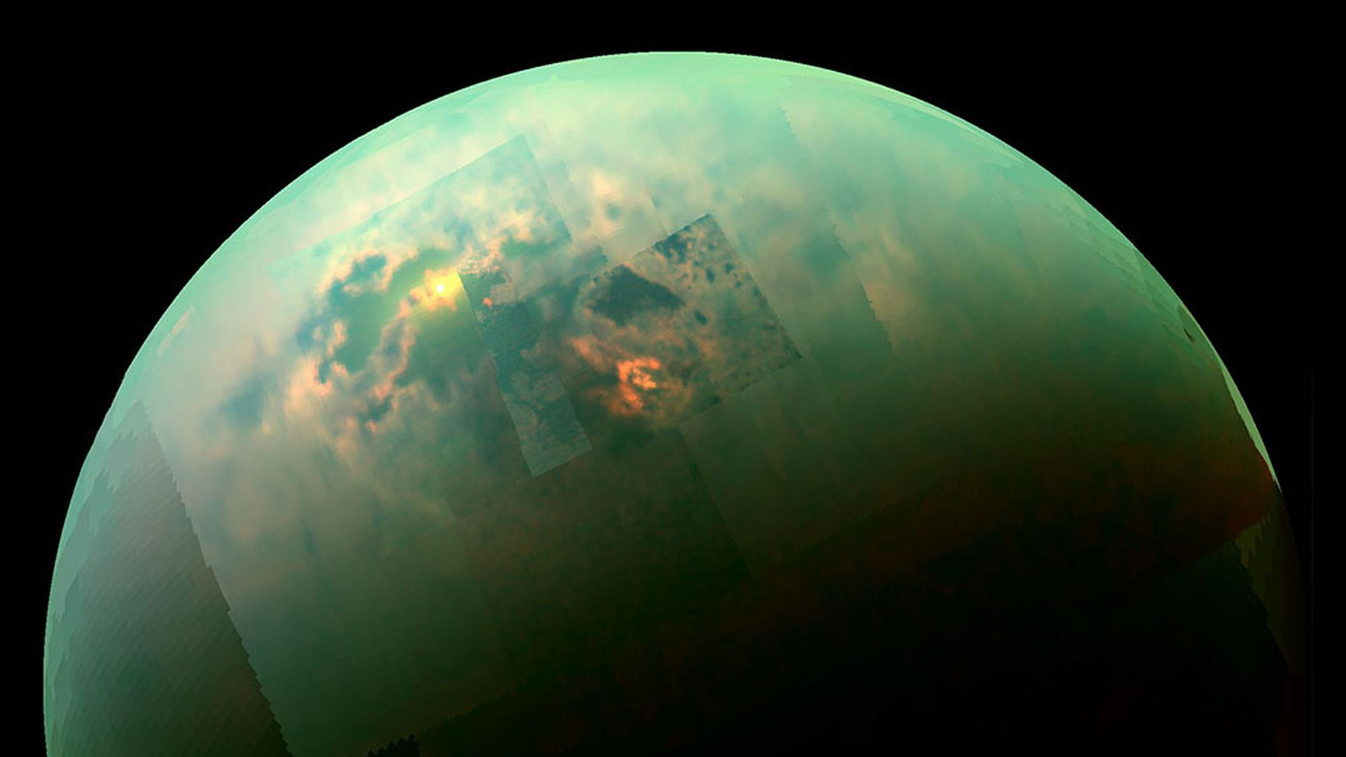 This is an image from NASA of Saturn's moon Titan, which is blueish green.