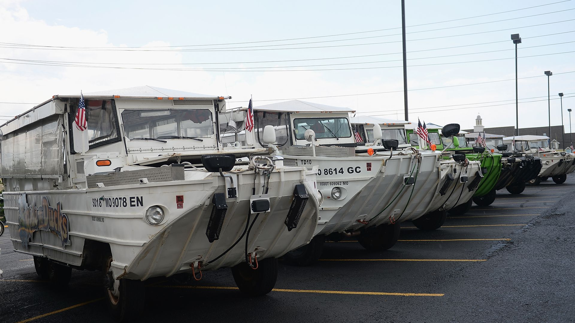 The fleet of the World War II DUKW boats are seen at Ride the Ducks on July 20. Hundreds of mourners stopped by to pay their respects to the victims after a duck boat capsized.