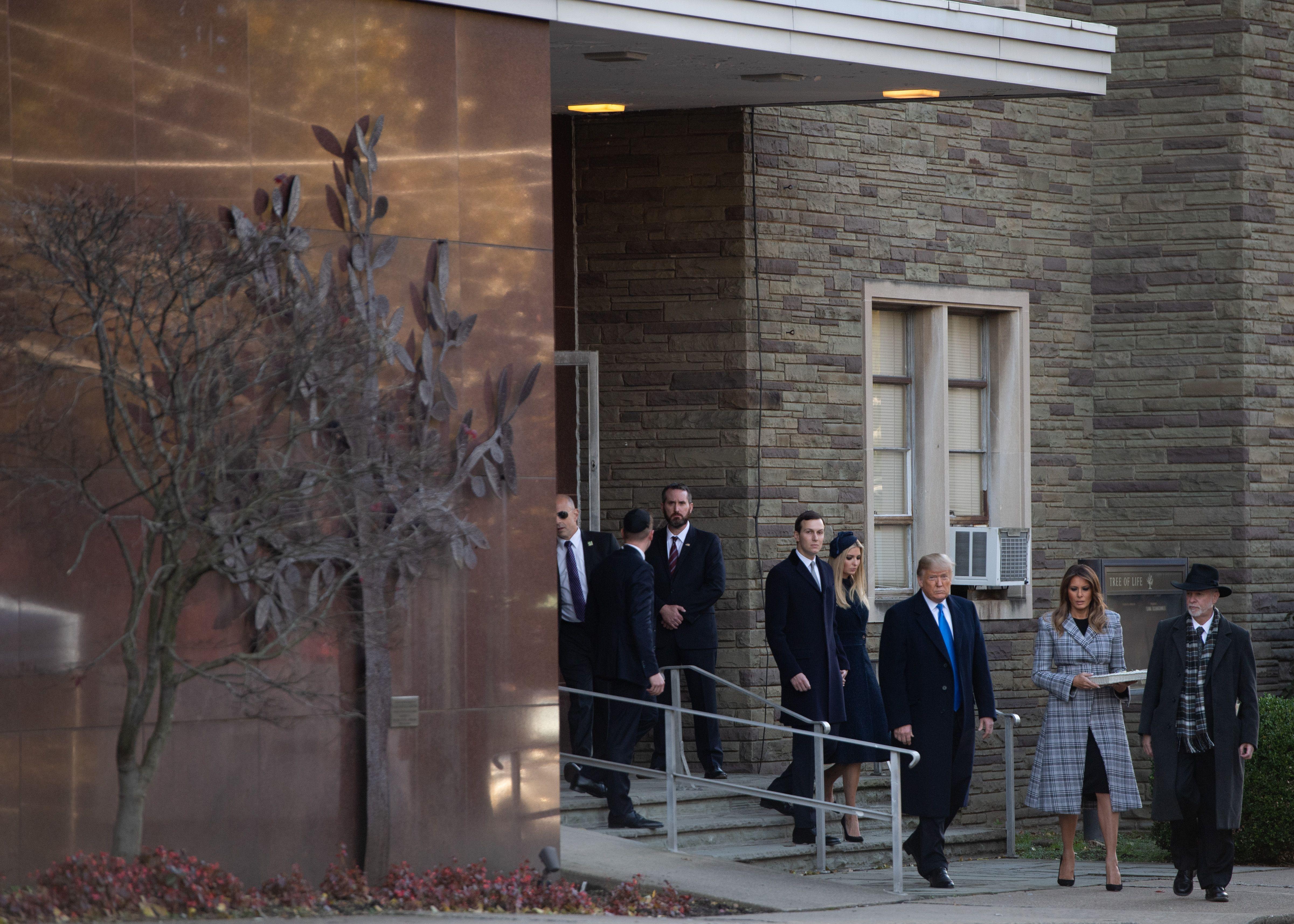 Trump, family exit synagogue.