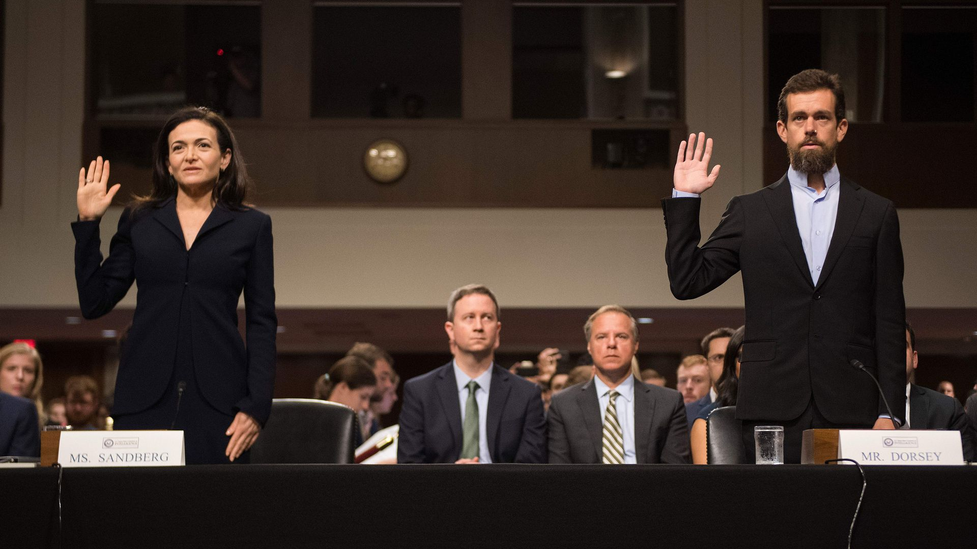 Sheryl Sandberg and Jack Dorsey being sworn in
