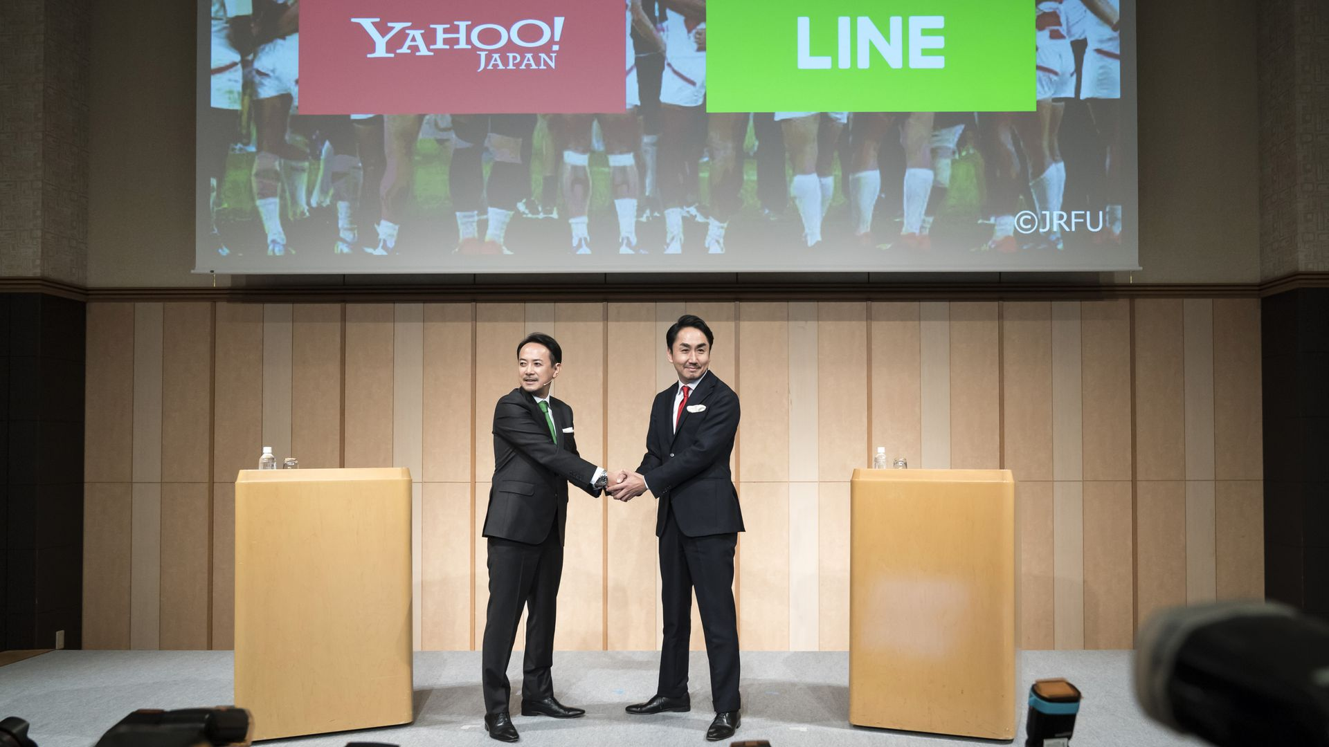 Yahoo Japan and Line Hold Corp. representatives hold a joint press conference on Nov. 18.