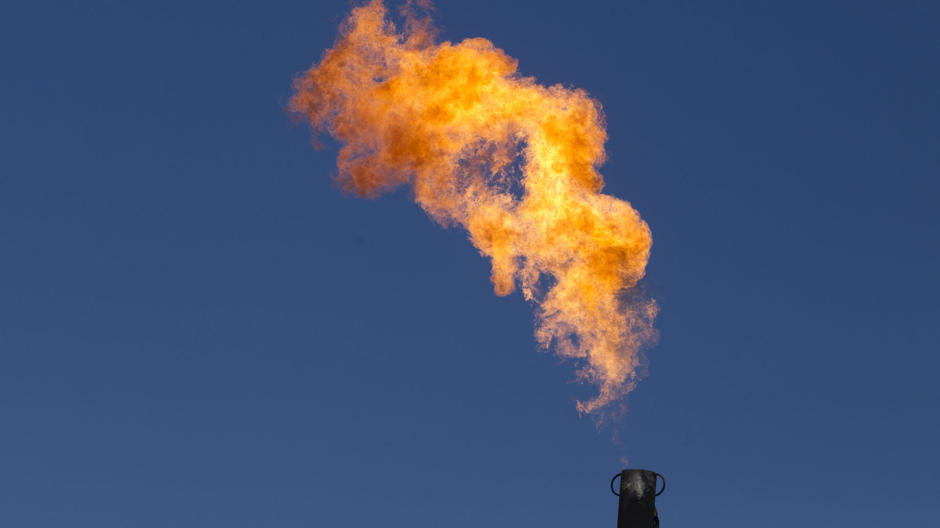 Excess natural gas is burned off at a well in Texas.