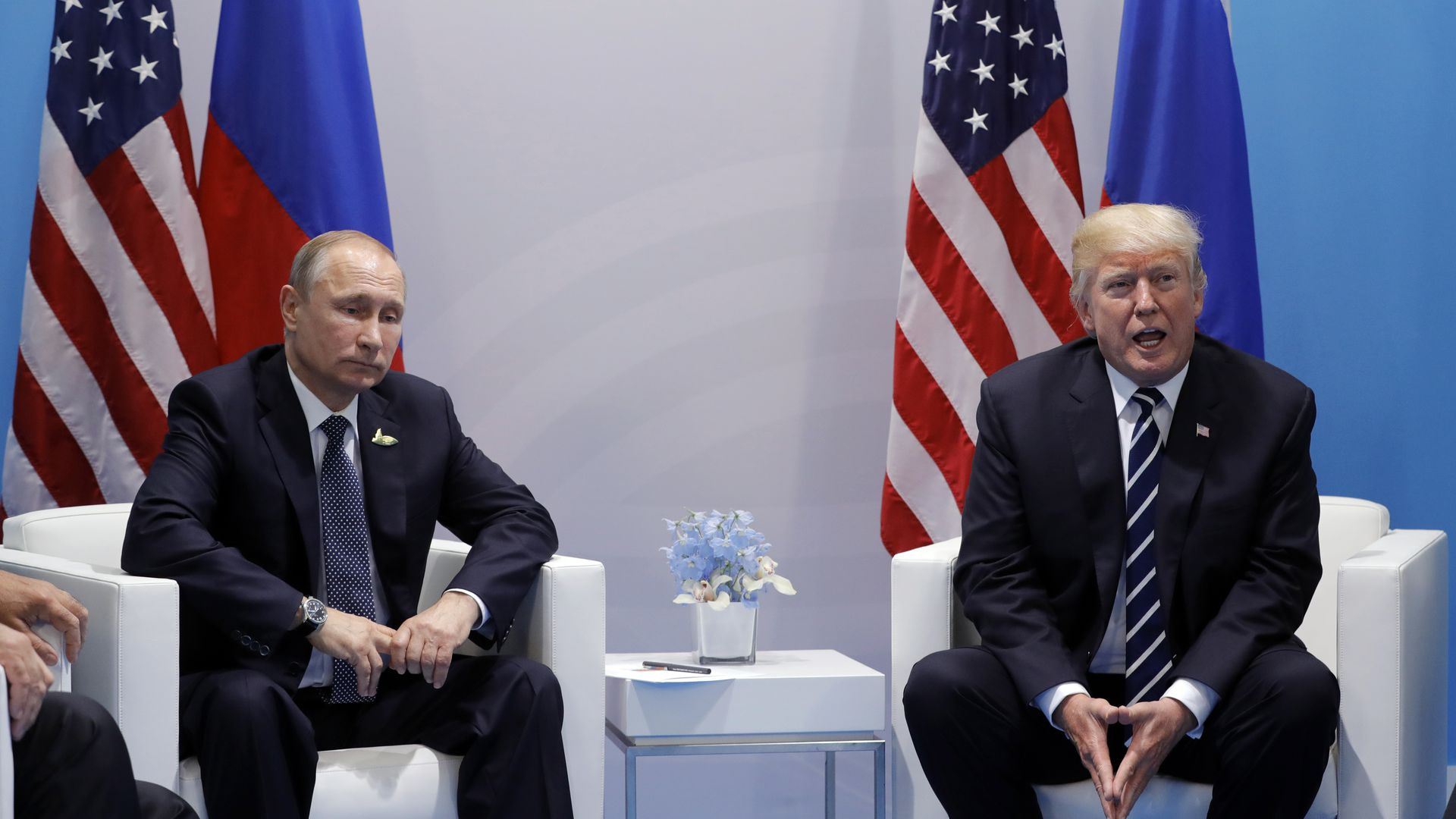 Trump and Putin sit across from one another during a bilateral meeting in Germany last year