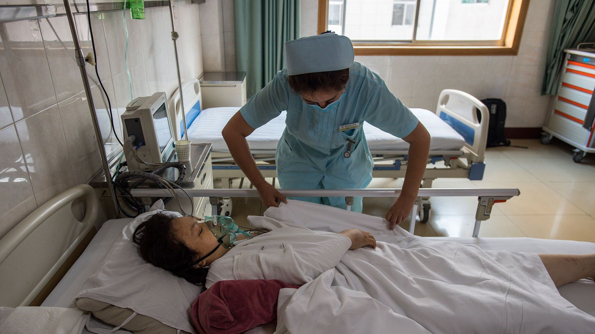 A nurse treats a patient in a Chinese hospital.