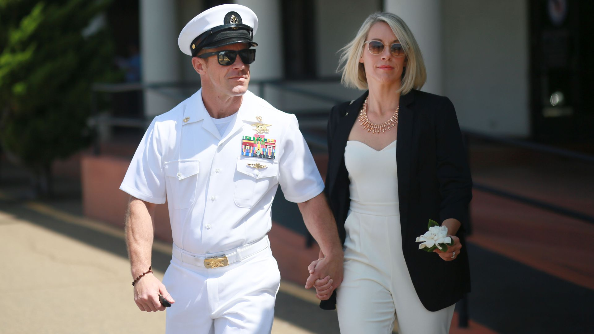 Navy Special Operations Chief Edward Gallagher walks out of military court with his wife