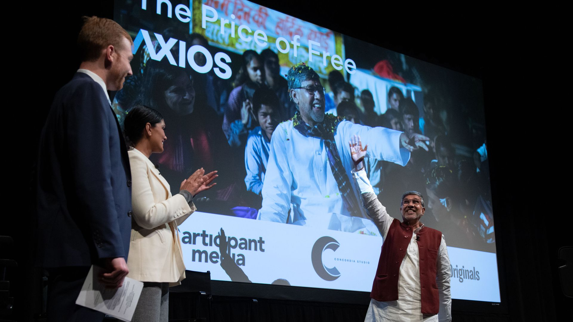 Kailash Satyarthi takes to the Axios stage waving to the crowd