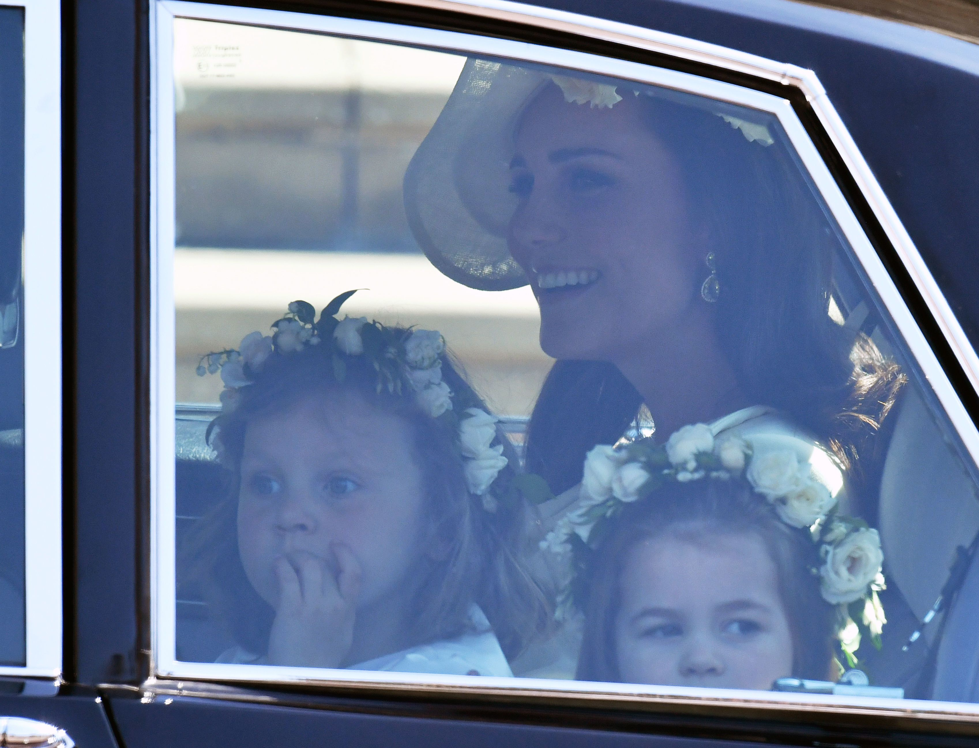 Catherine, Duchess of Cambridge arrives with Florence van Cutsem (L) and Princess Charlotte