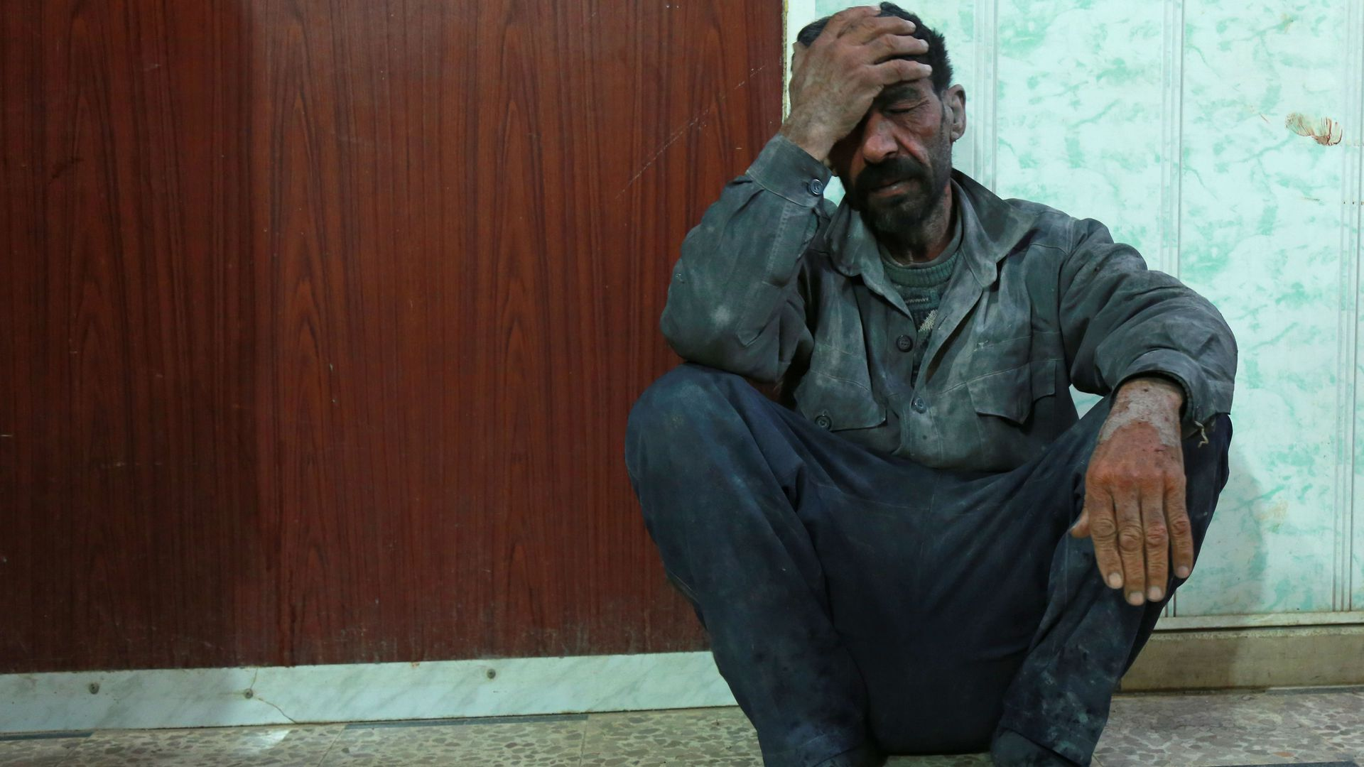 A Syrian man awaits to be treated at a makeshift hospital in the besieged Eastern Ghouta region.