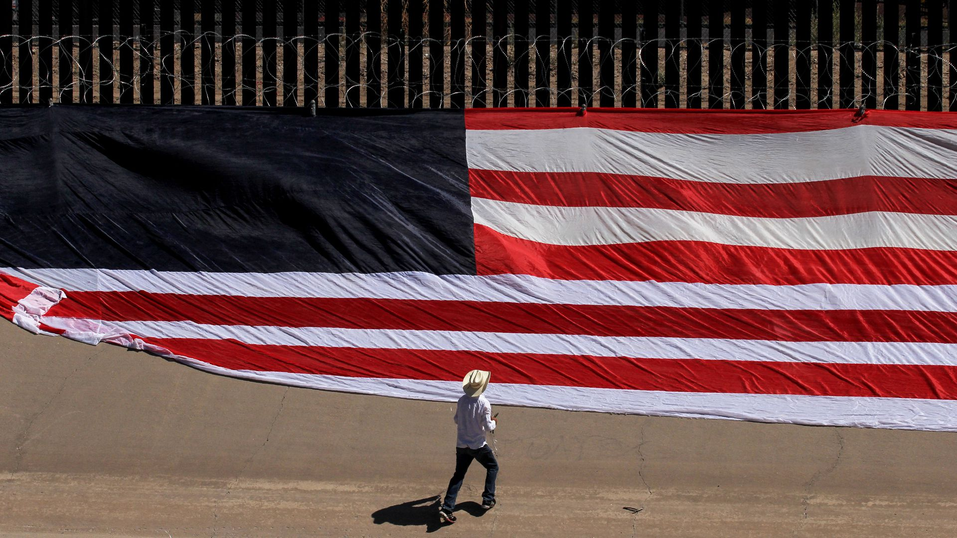 A United States national flag on the border wall next to Rio Grande river on June 6, 2019.
