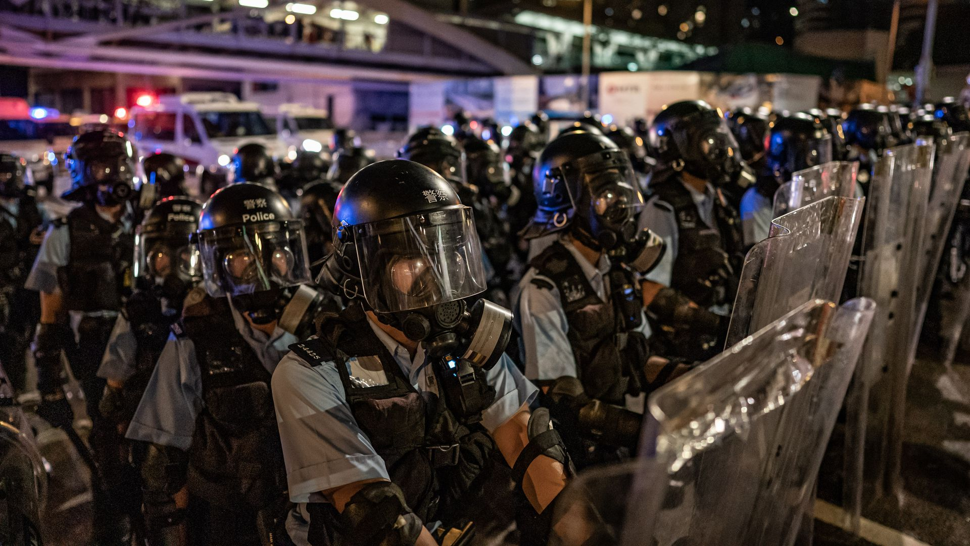 Thousands of pro-democracy protesters faced off with riot police on Monday during the 22nd anniversary of Hong Kong's return to Chinese rule as riot police officers u