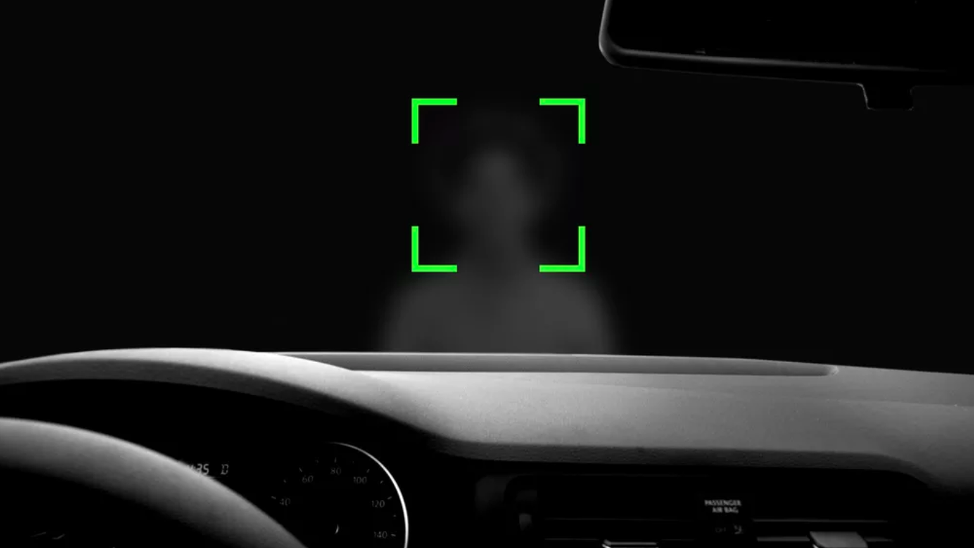 In this illustration, the viewer looks through the windshield from inside a car and sees a green square around a blurred persons face.