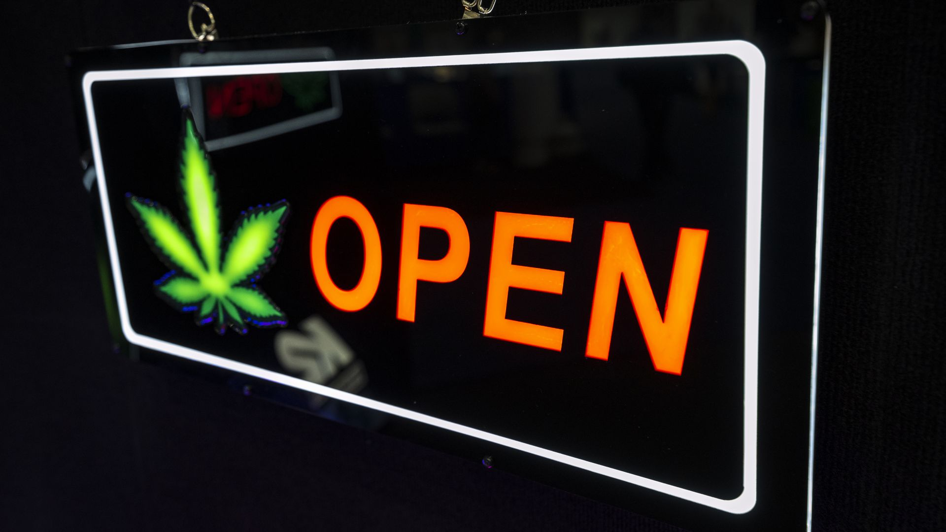 An open side with a neon marijuana leaf