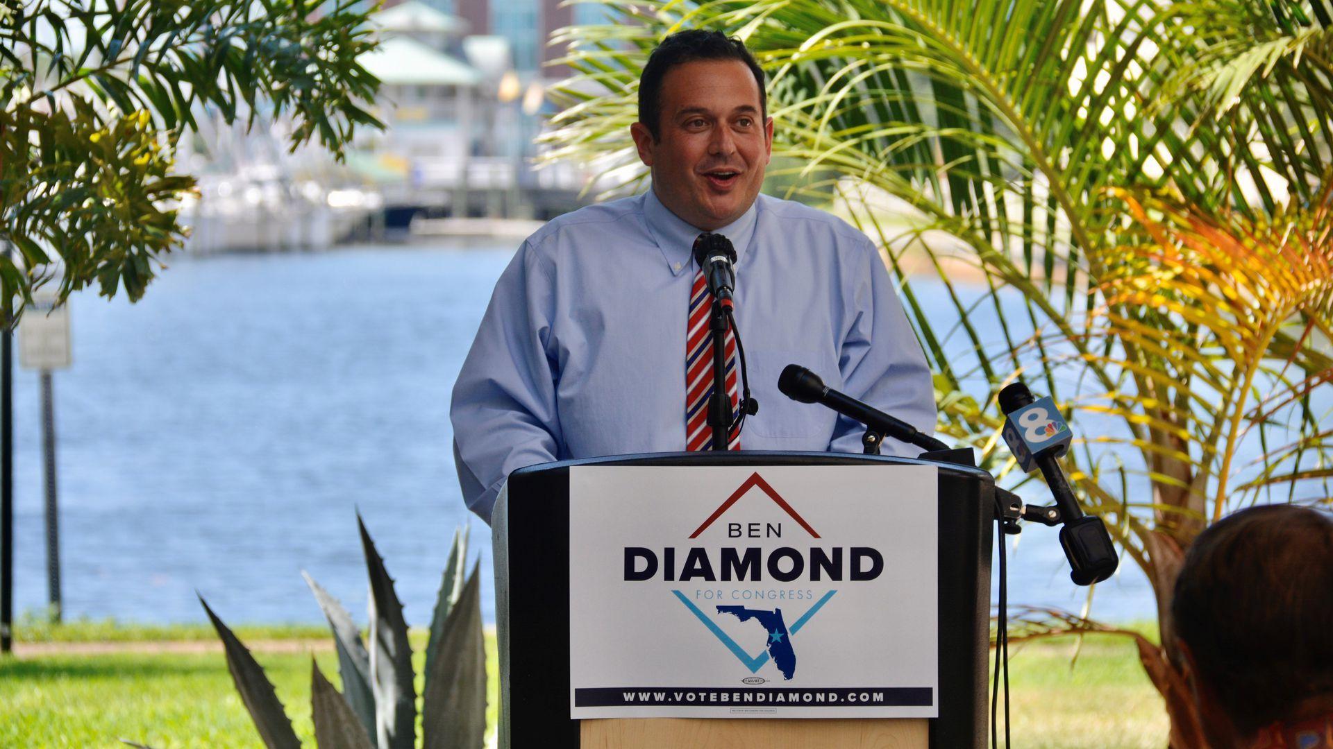 Ben Diamond stands at a podium