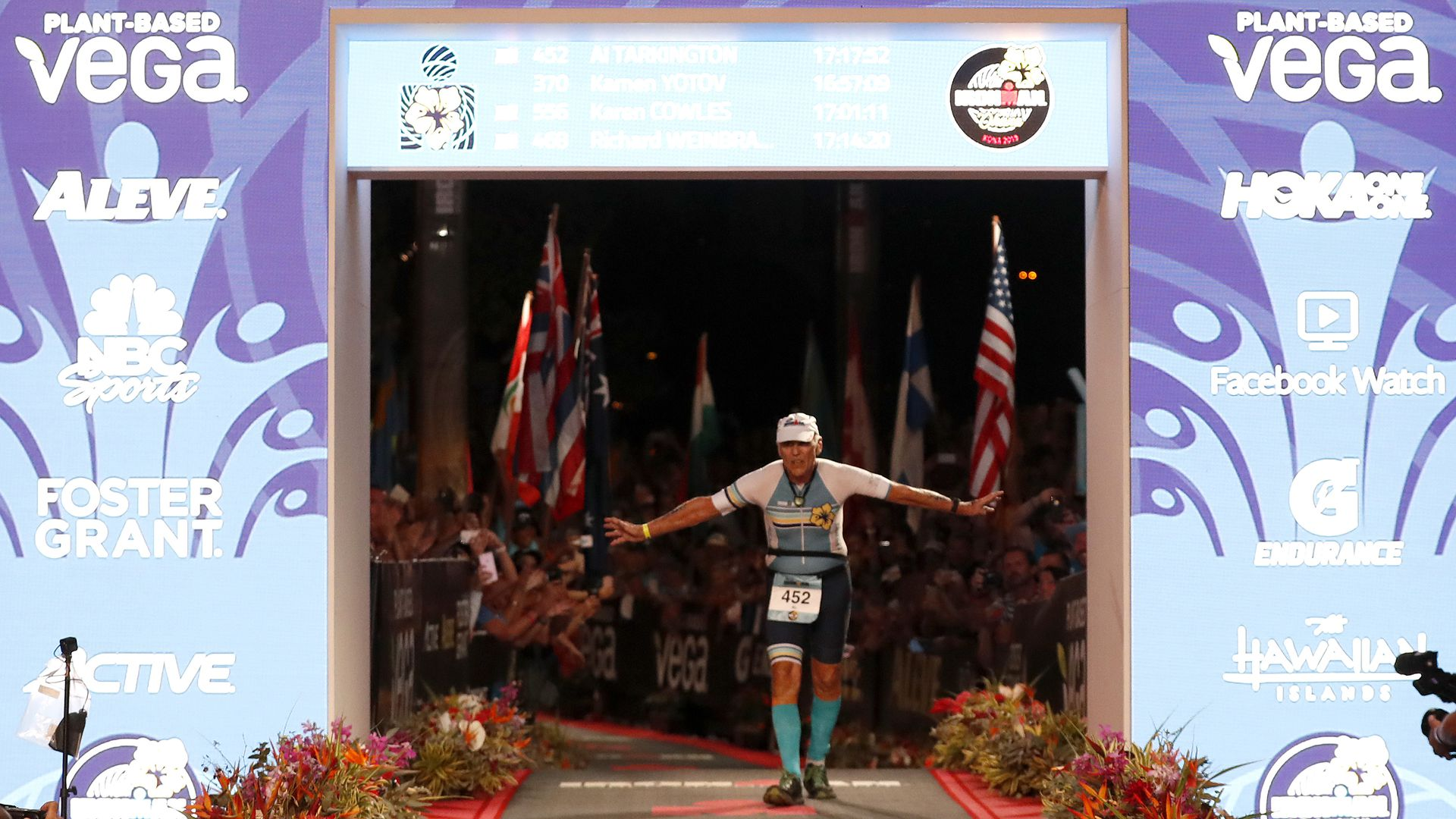 Al Tarkington, 80-years-old, of the United States is the final finisher at the Ironman World Championships