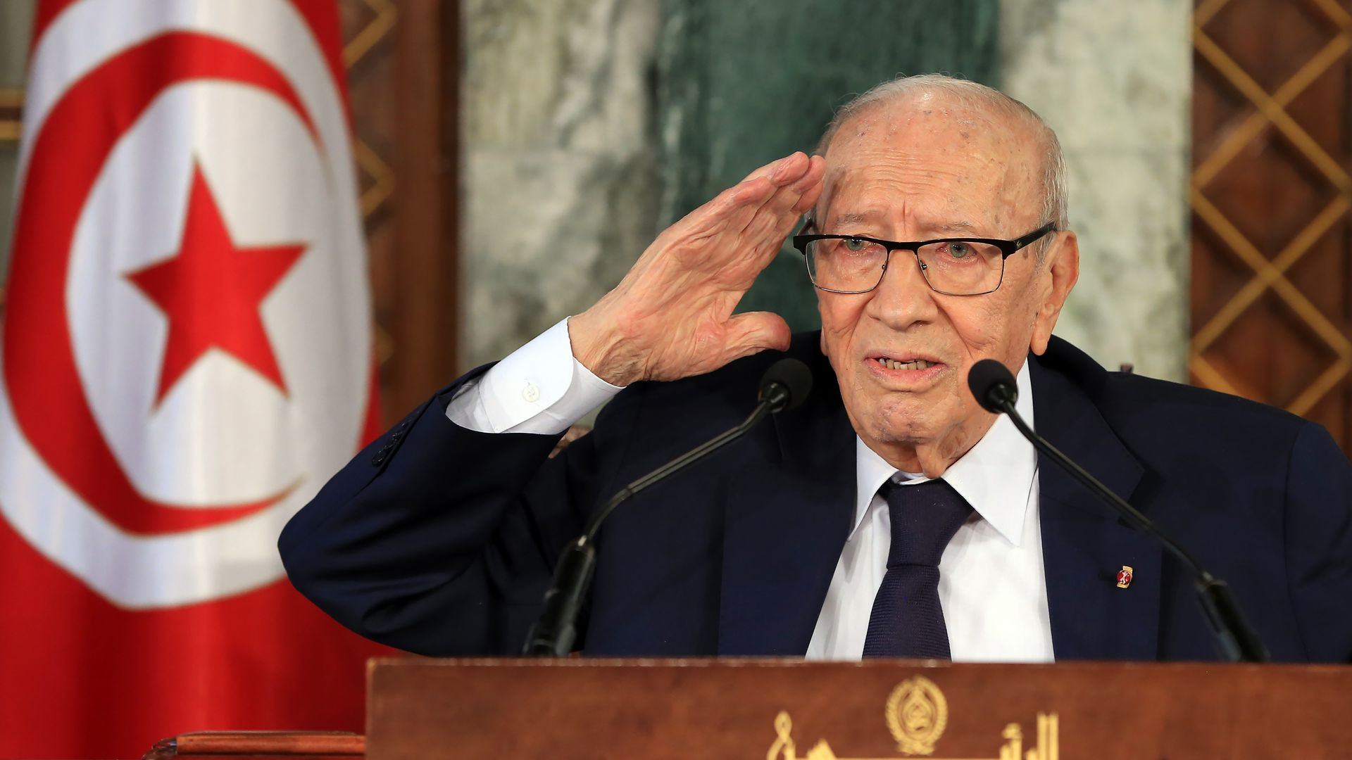 Beji Caid Essebsi standing at a lectern