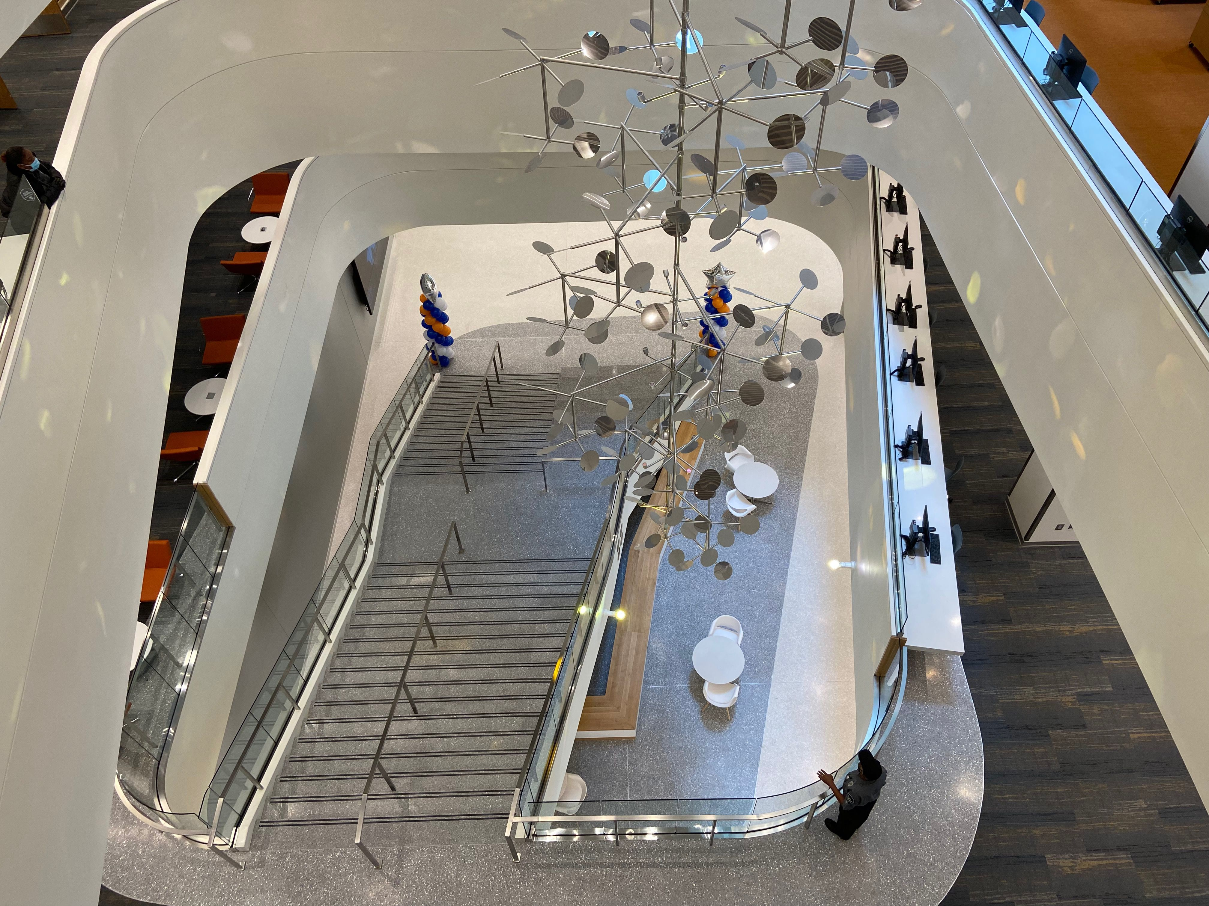 An aerial photograph overlooking the central staircase and central airway that floods the Central Library with daylight