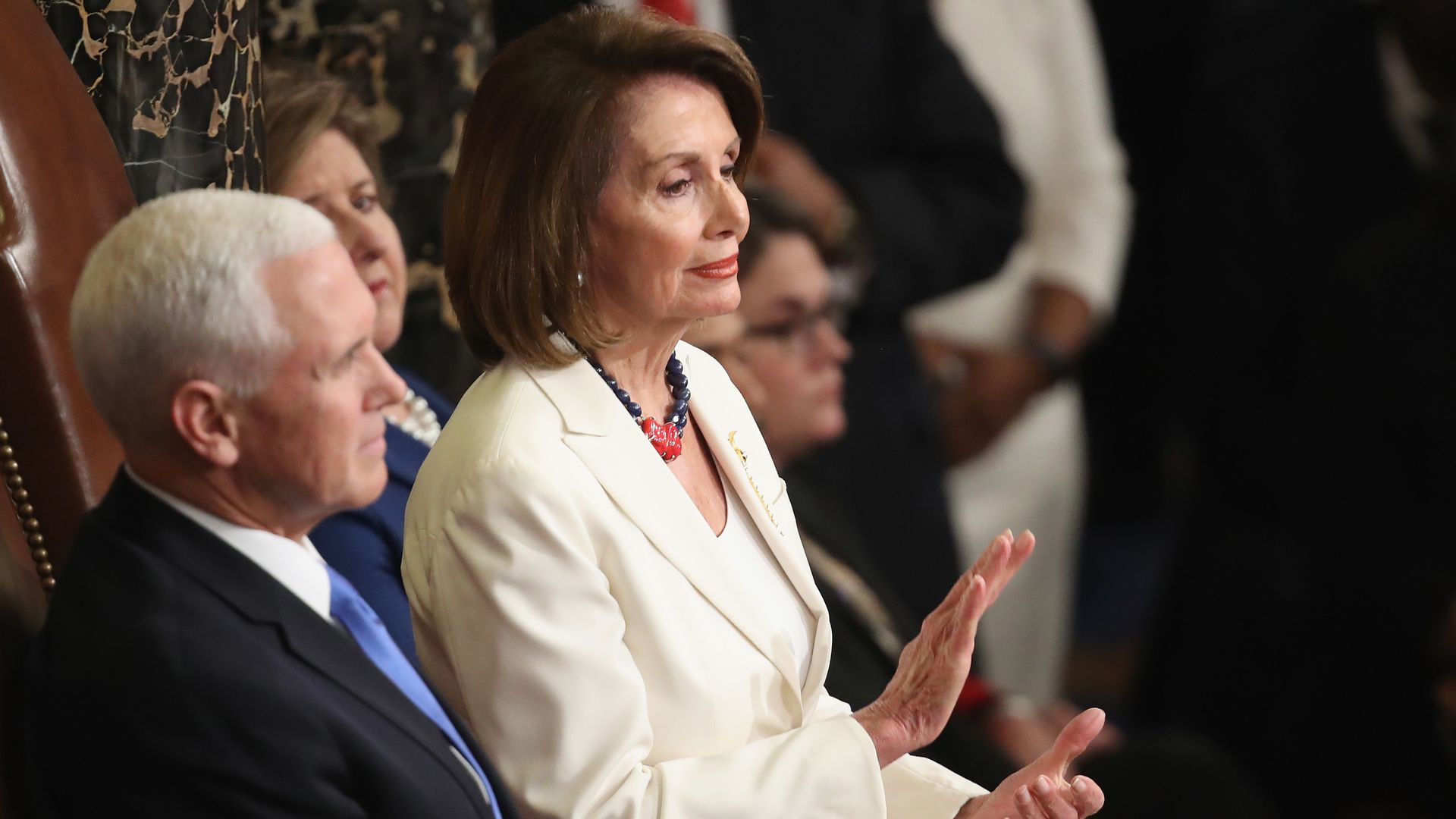 NAncy Pelosi at state of the union next to mike pence