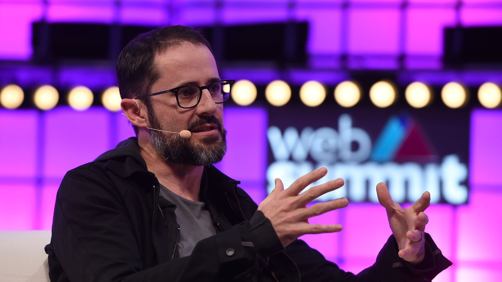 Photo of Twitter co-founder Ev Williams speaking on conference stage.