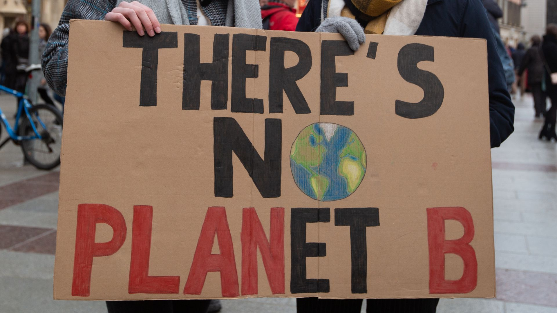 "Two women holding a sign that says ""there's no planet B"""