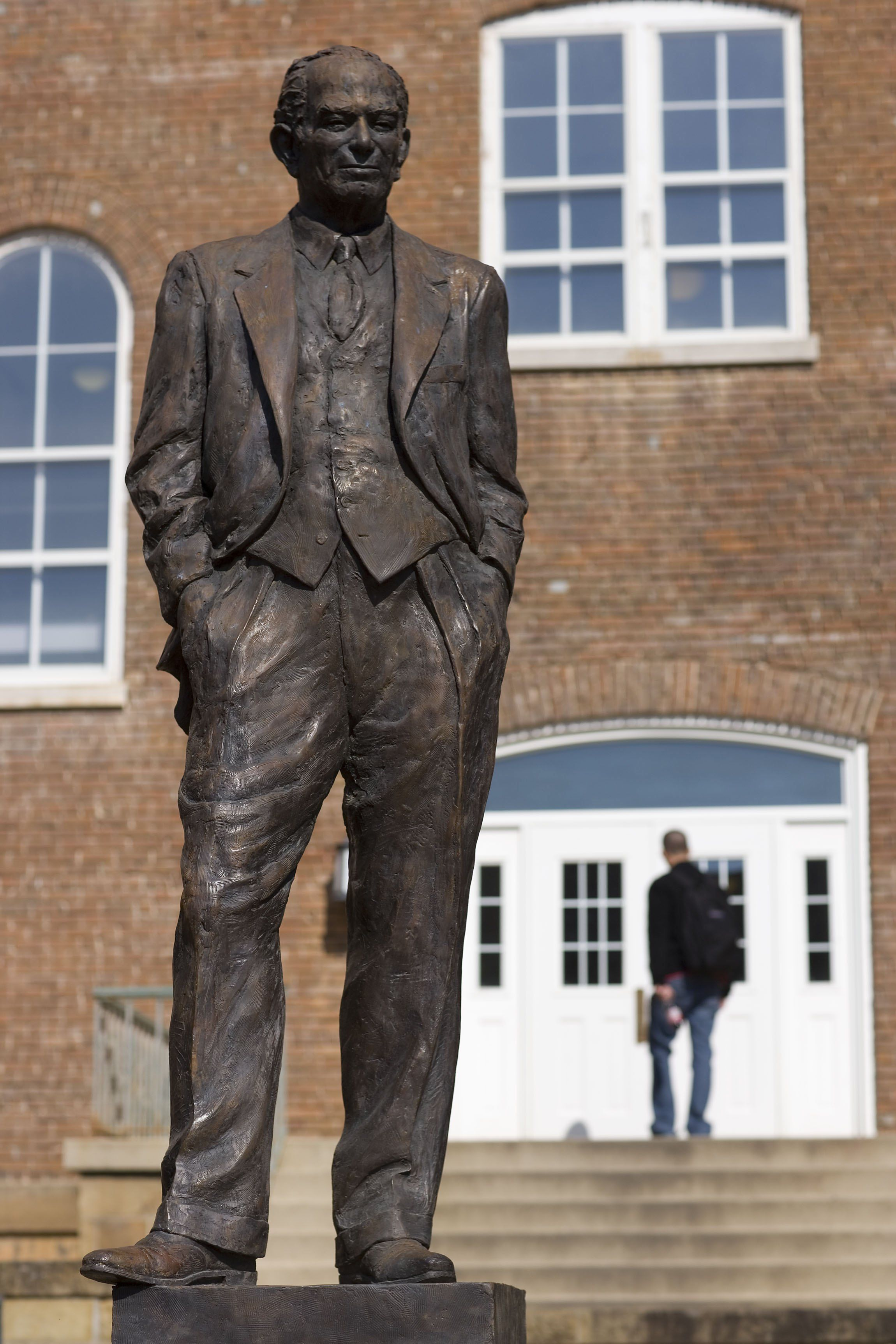 The J. William Fulbright statue behind the Old Main building on the University of Arkansas campus. Photo: Wesley Hitt/Getty Images
