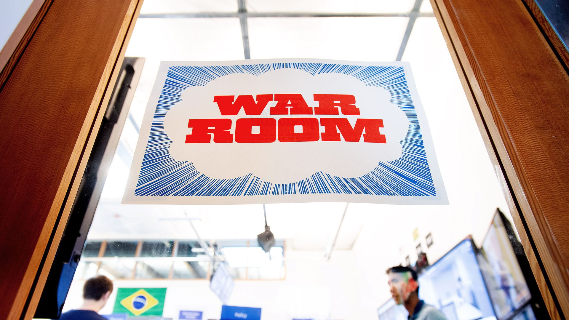 """A sign reading """"War Room"""" on a glass door"""