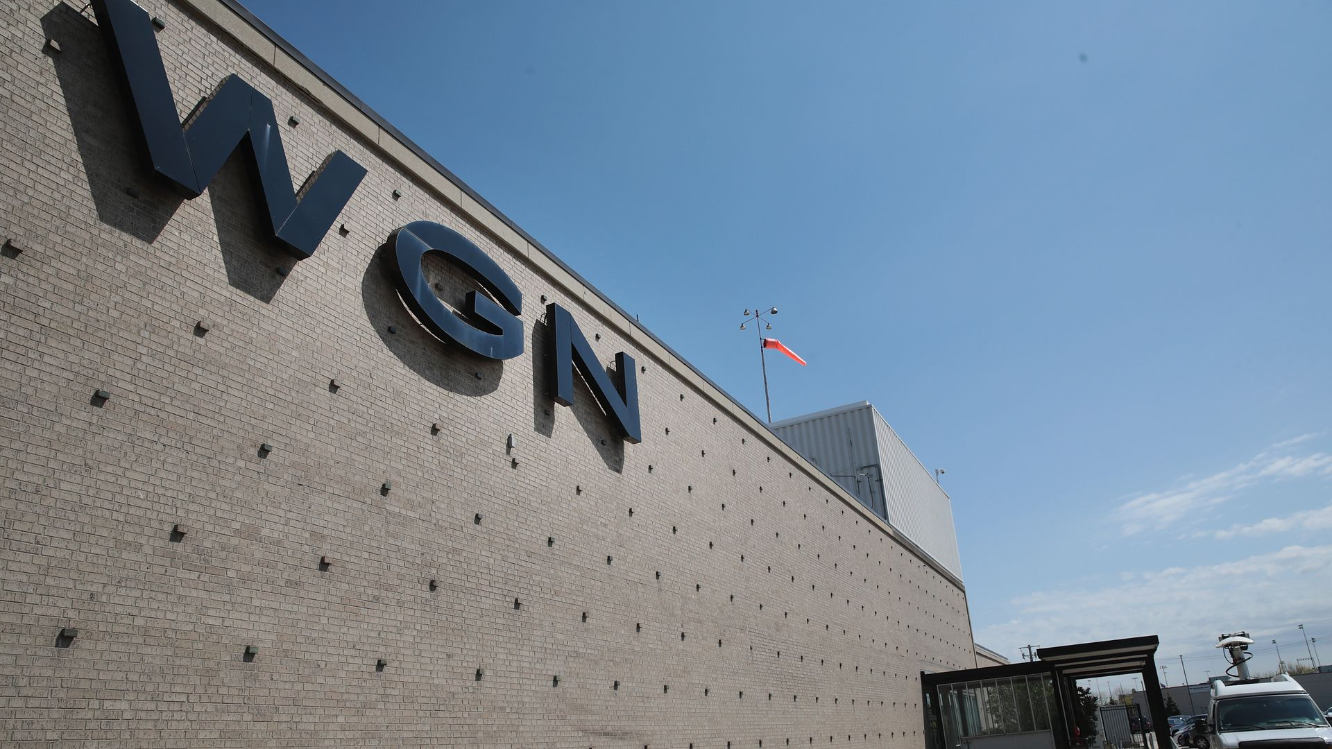 Signage for Chicago station WGN on the side of a building