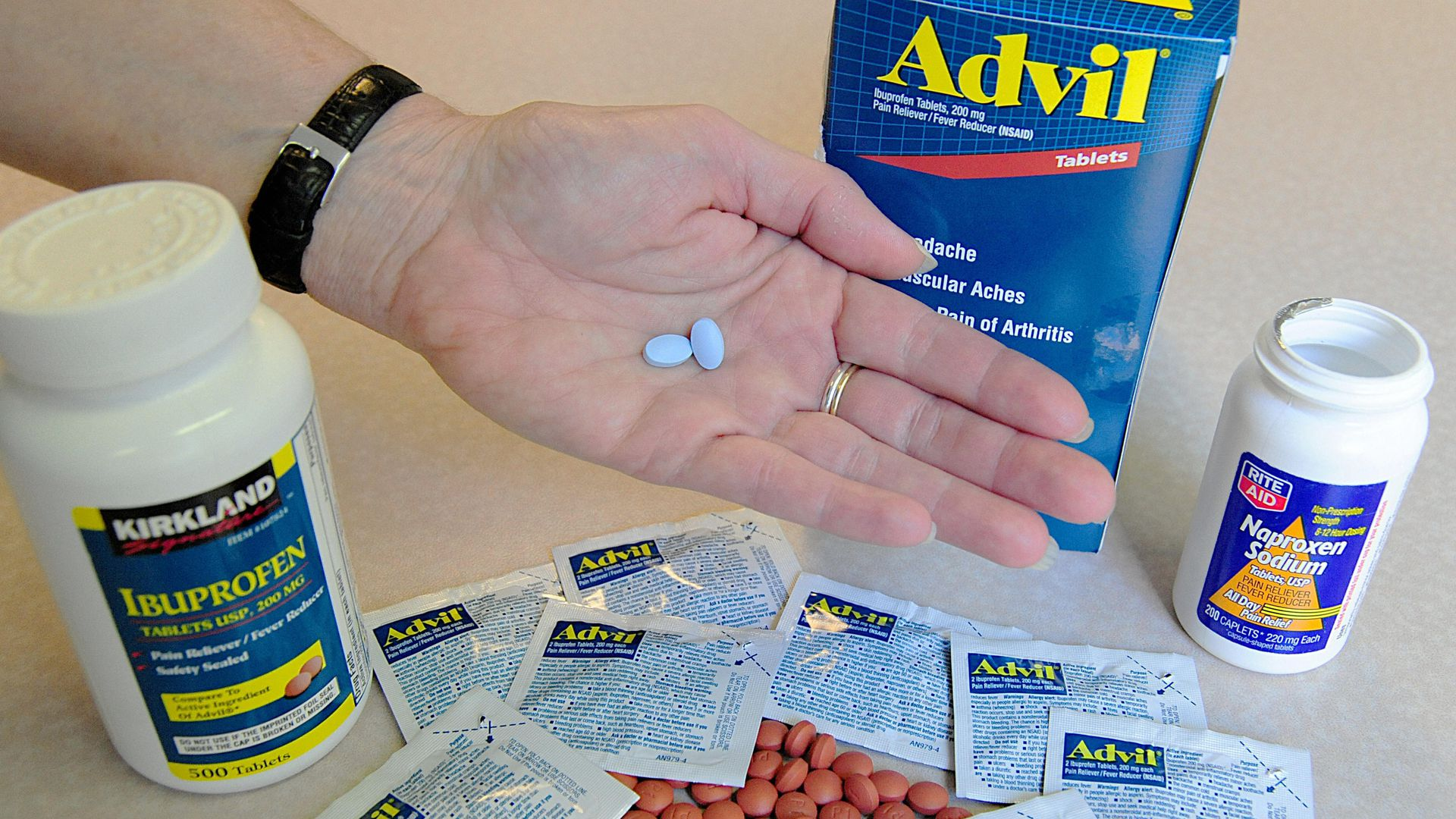 Brand and generic over-the-counter pain medications.