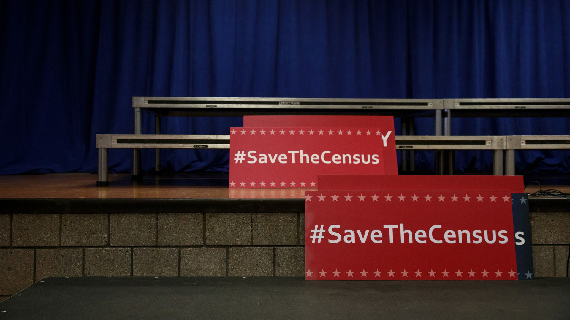 "Signs that read ""#SaveTheCensus"""