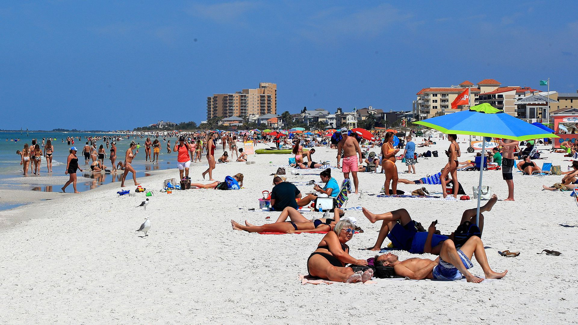 People gather on a beach for spring break in 2020.