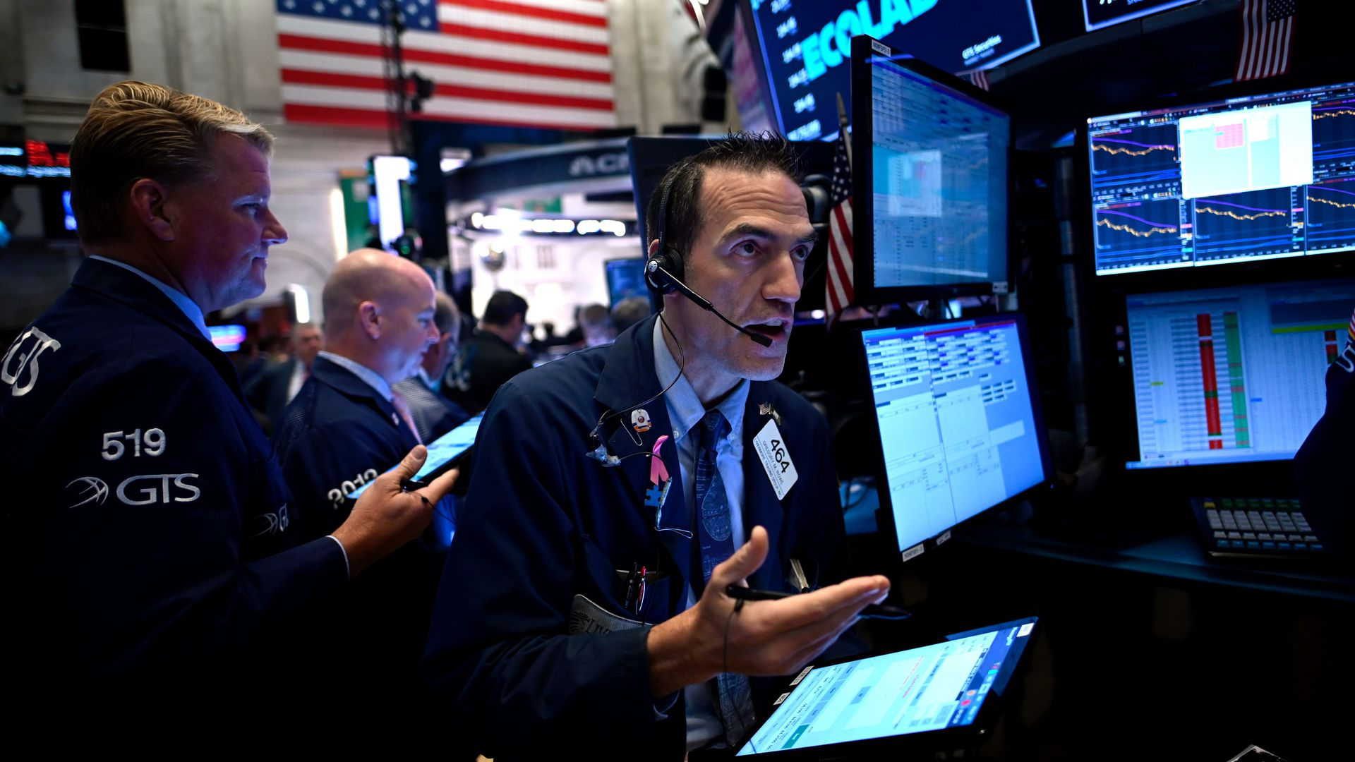 Traders work during the opening bell at the New York Stock Exchange (NYSE) on October 2